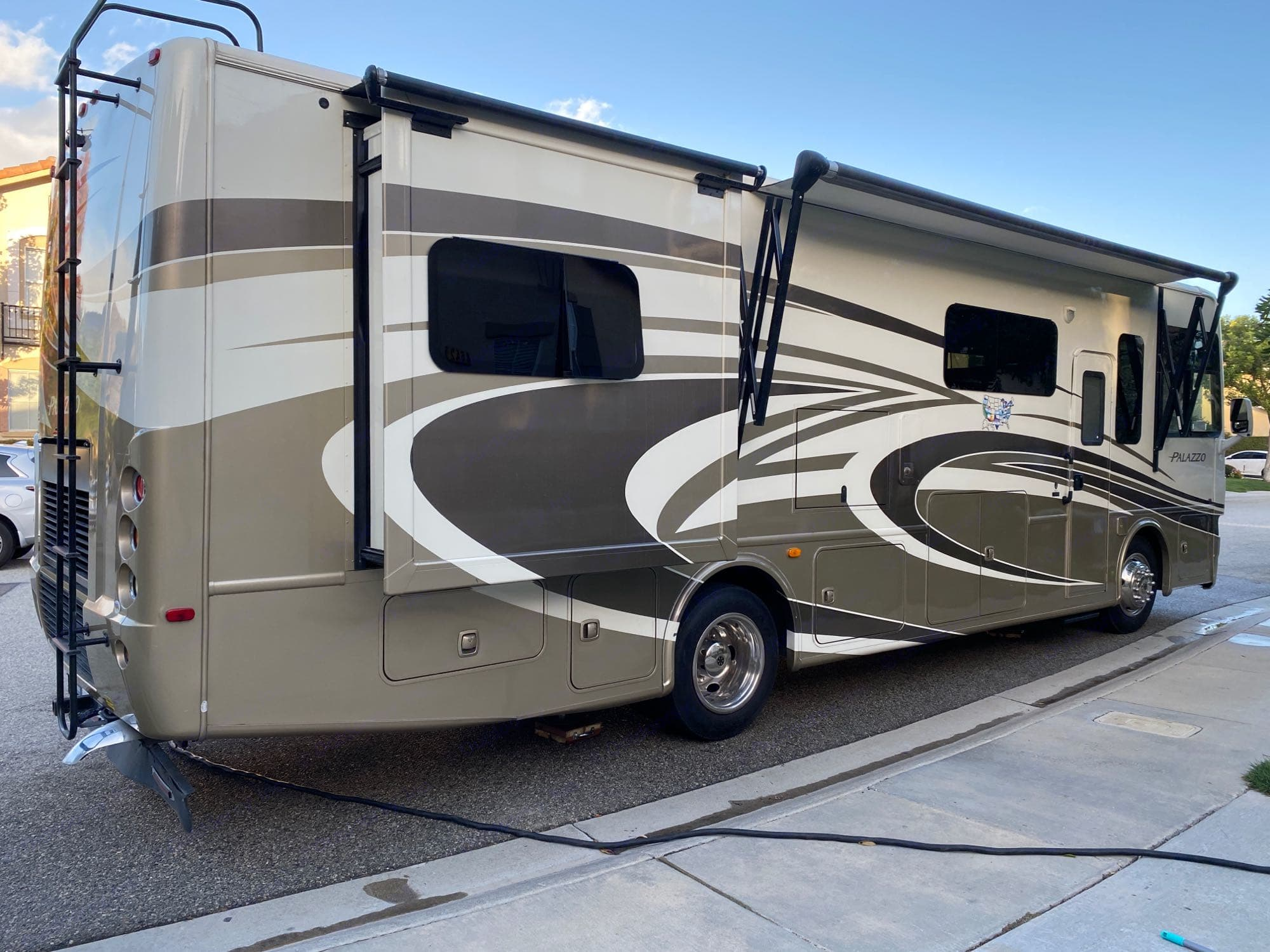 Showing one slide out and awning partially out. Thor Motor Coach Palazzo 2014