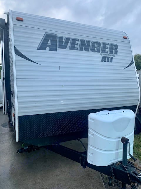 Front of Camper with Two Full Size Propane Tanks. Prime Time Avenger 2015
