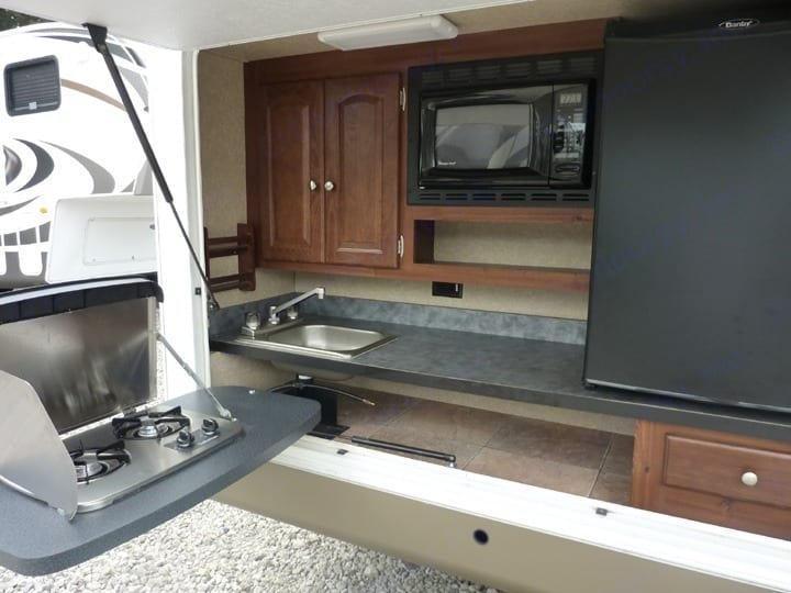 Amazing outdoor kitchen + attached propane grill not shown in pic. Forest River Rockwood Signature Ultra 2012