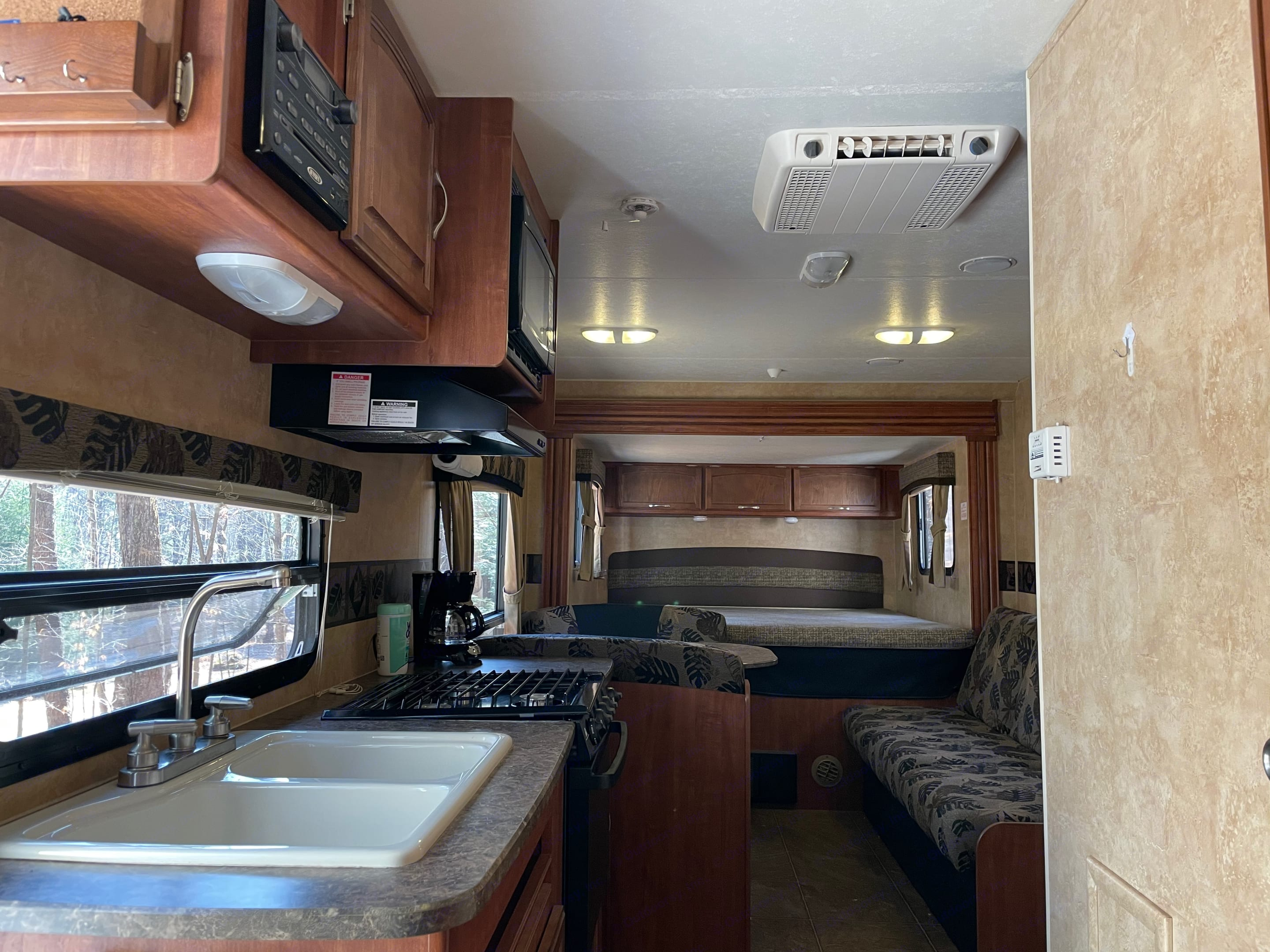 Double sink, radio, air conditioner, range, and stove vent.. Jayco Jay Feather Select 2011