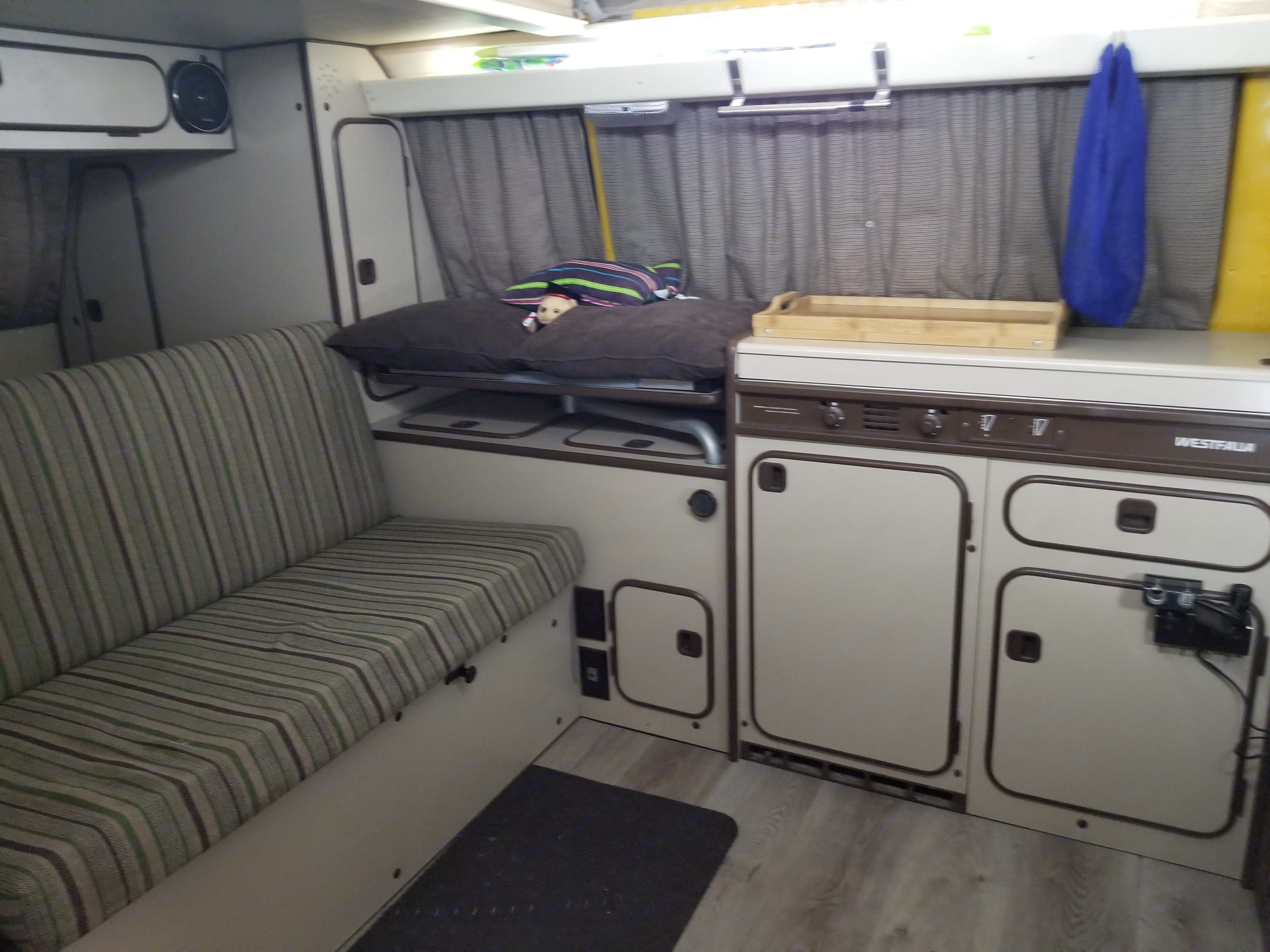 Cozy space with brand new laminate flooring for a great accent . Volkswagen Westfalia 1982
