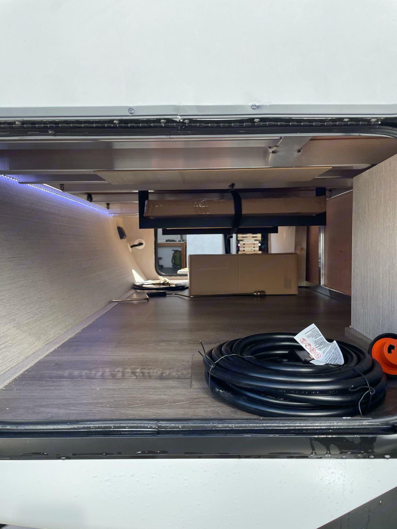 Large front storage area. Coachmen Freedom Express 2021