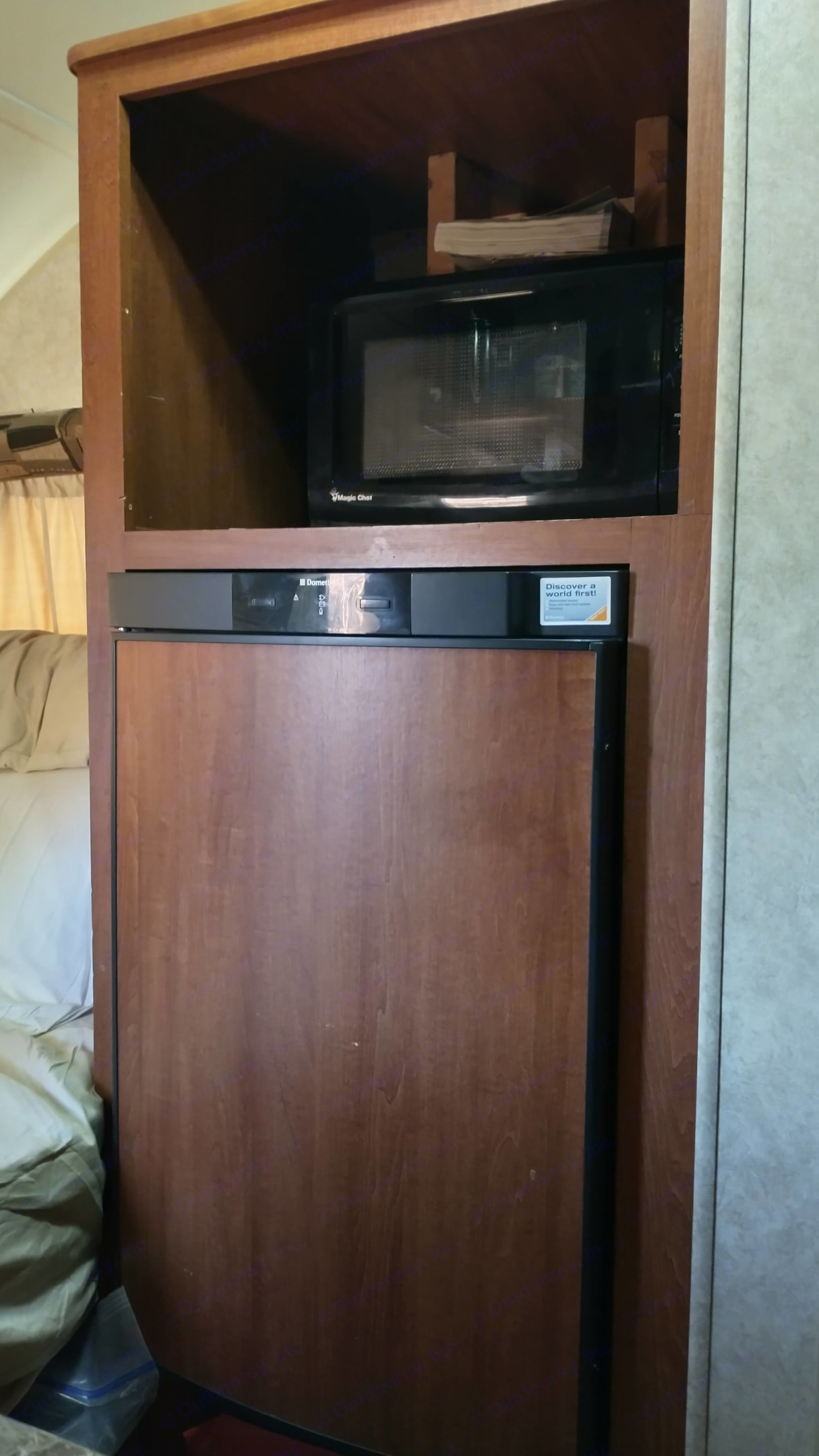 Refrigerator and Microwave for storing and preparing food. Forest River R-Pod 2011