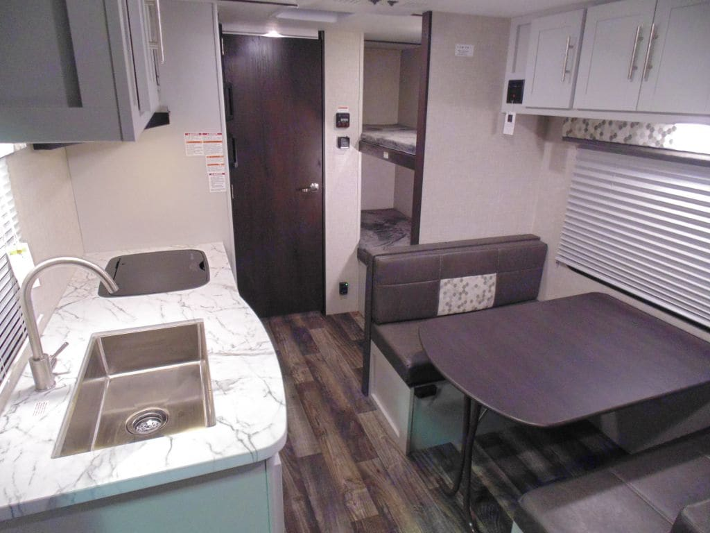 Bright and open the dinette converts into a bed and also has plenty of storage under the bench cushions and above the dinette. . Keystone Bullet 2020