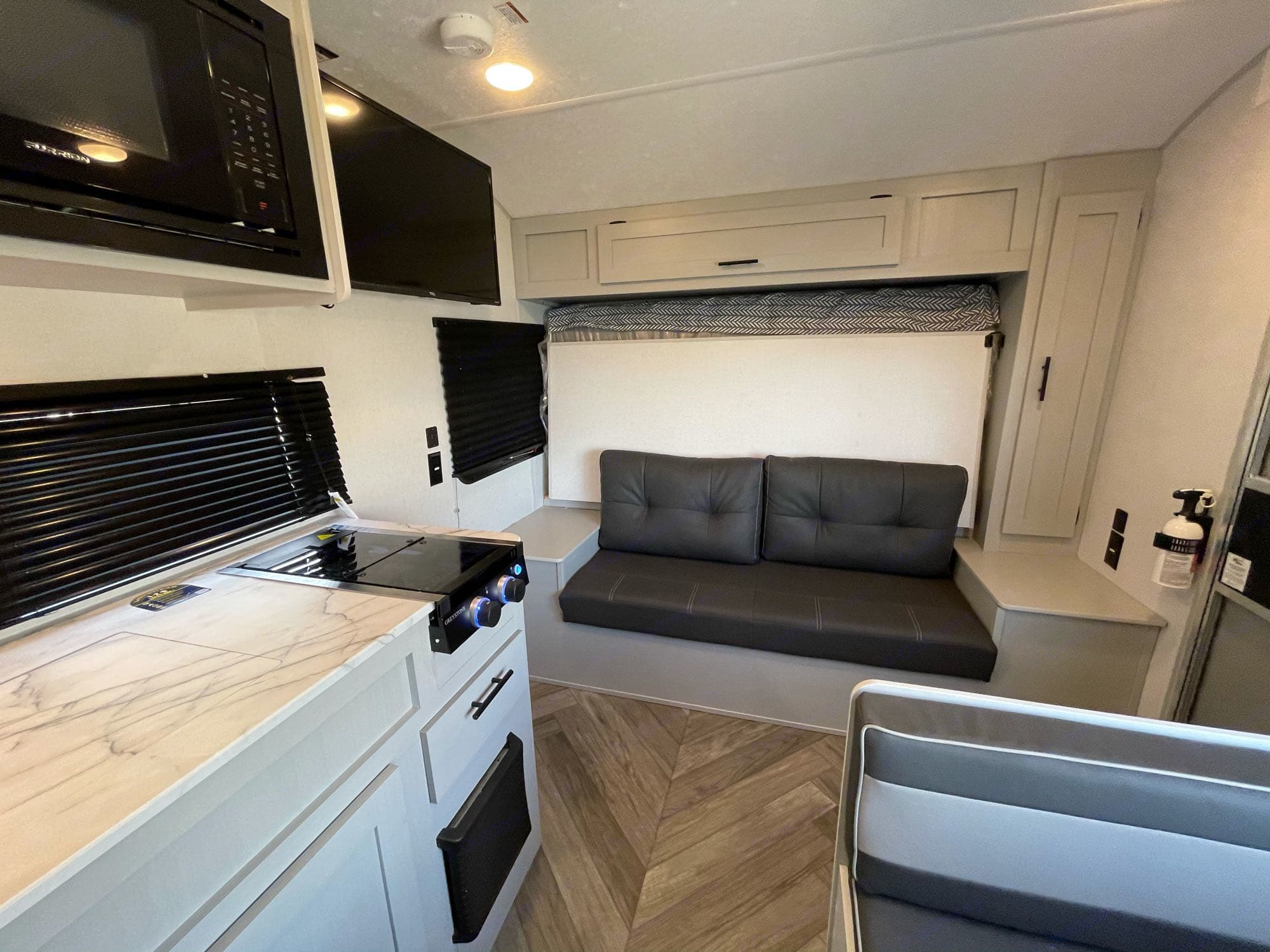 Murphy bed allows this 22ft travel trailer tons of open space for hanging out on a rainy day.. Forest River Salem 2021
