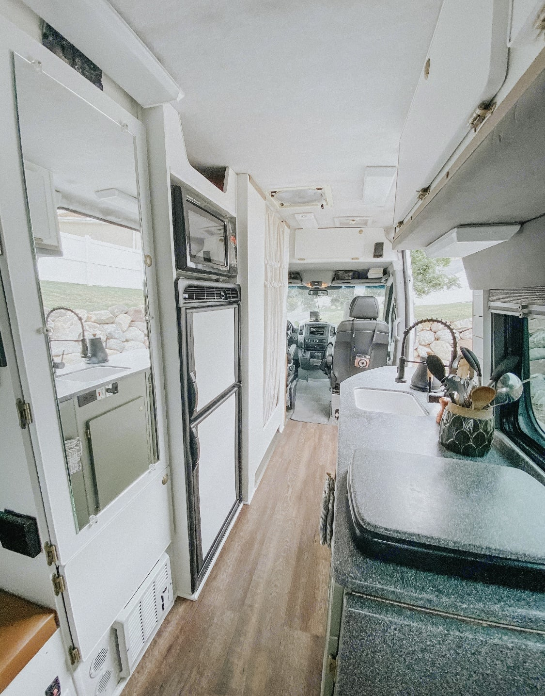 Double burner stove, kitchen sink, large fridge/freezer, and an entire pantry space available for your use!. Mercedes-Benz Sprinter 2007