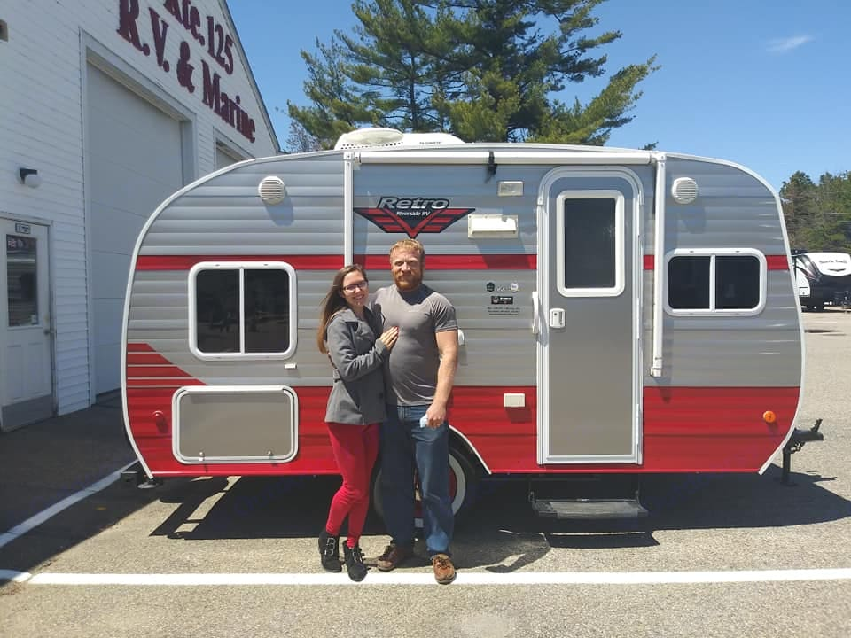 My wife Amber and I with the camper.. Riverside Rv Retro 2018