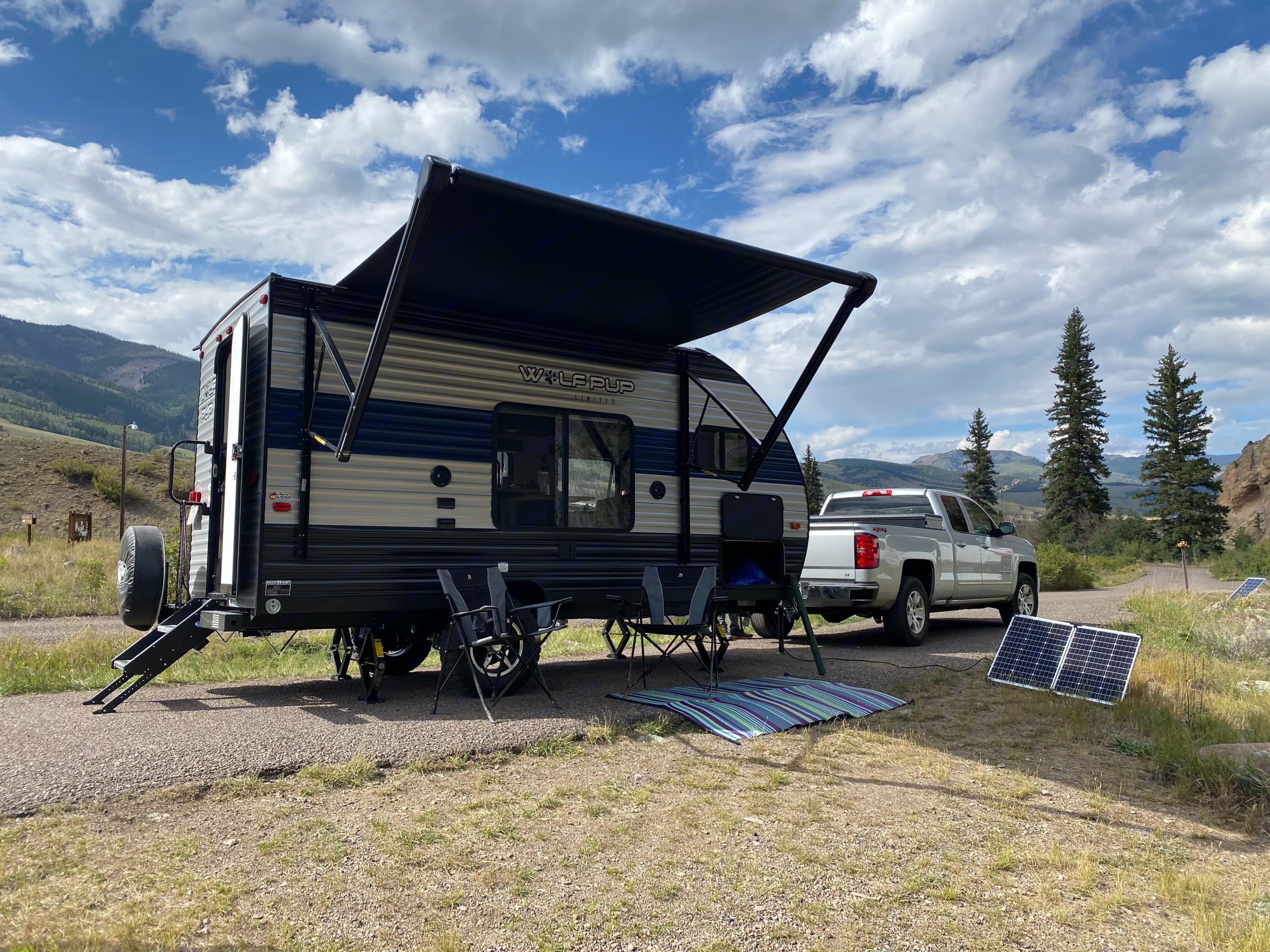 Camping at Marshall Park off the Rio Grande - 2 camping chairs, outdoor mat, 130 watt portable solar panel included with rental. Forest River Wolf Pup 2020