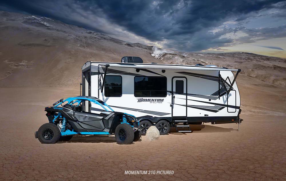 Load your bikes, kayaks, fishing gear, dirt bikes, etc... Grand Design Momentum 2020