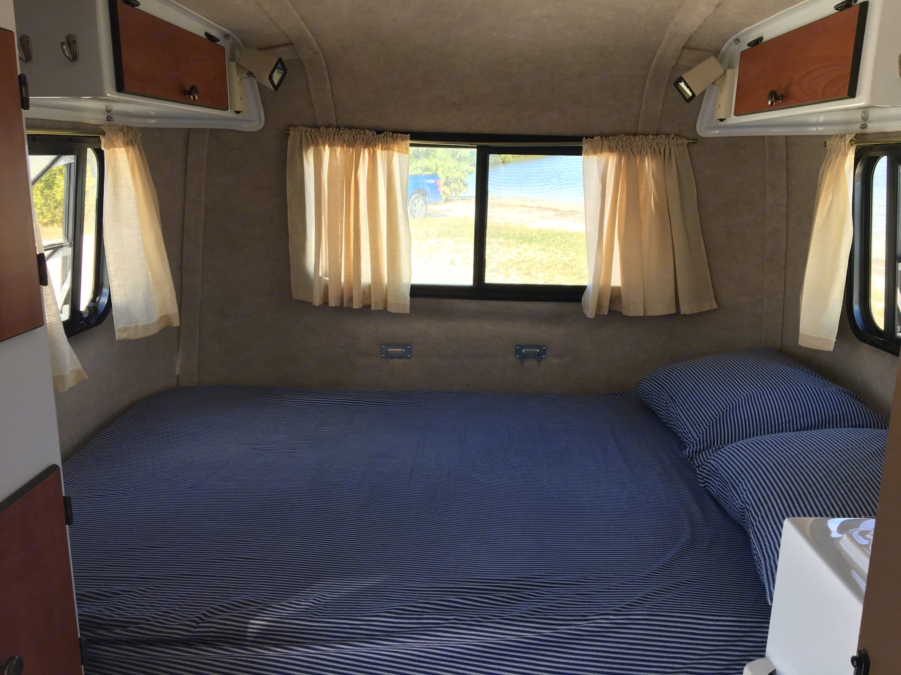 The bed is slightly smaller than a Queen. The cushions are very firm so i have included a foam mattress topper for additional comfort.. Scamp 13' 2017