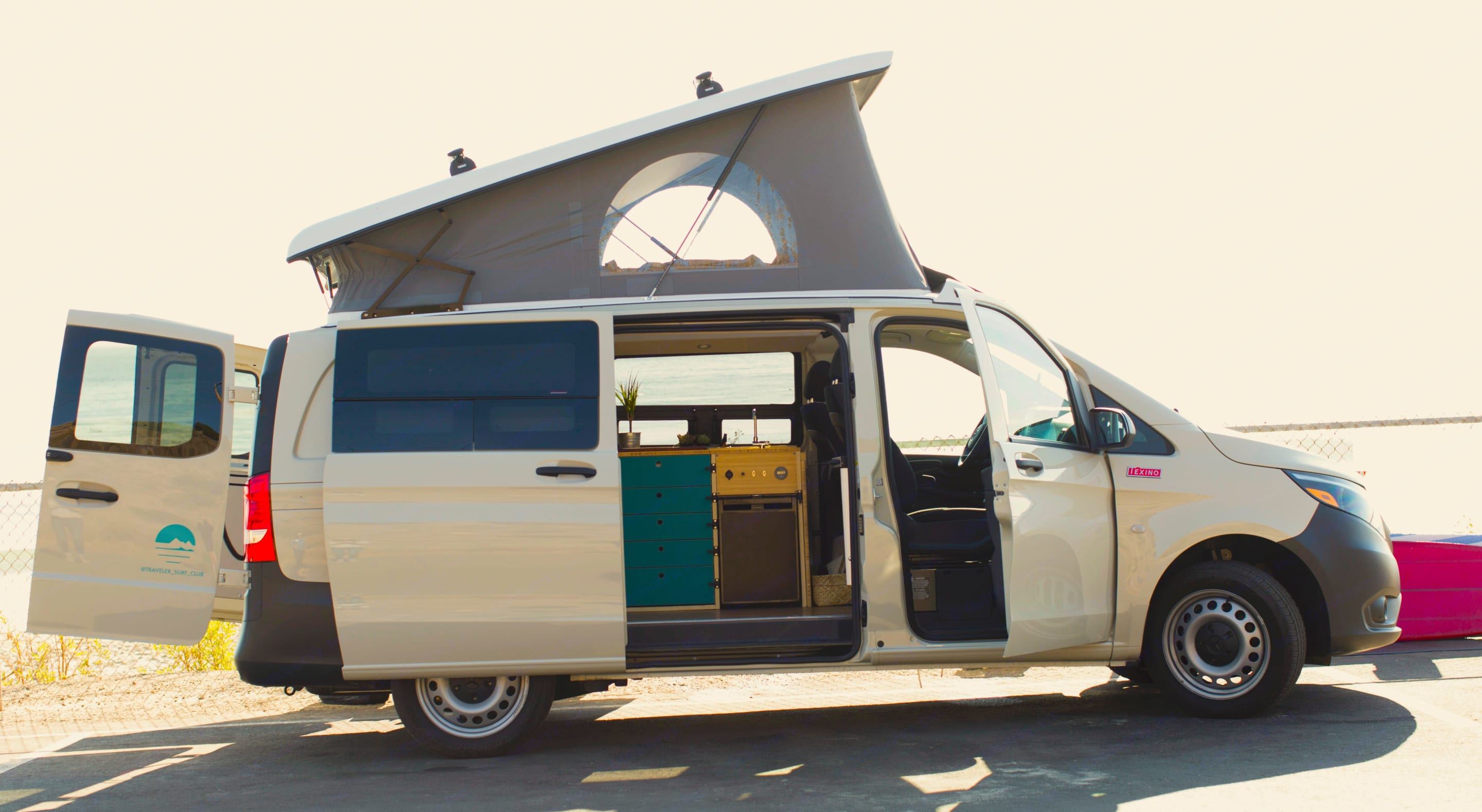 The Sandy Van opens up for ocean breezes and epic panoramic views! The Pop-top allows for easy standing room in the galley.. Mercedes-Benz Metris Pop-Top 2020