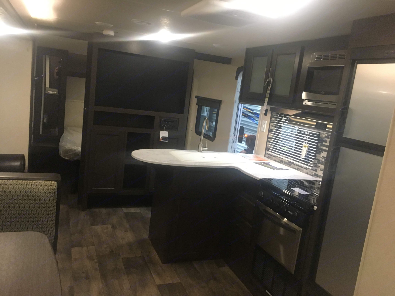 Kitchen View towards exit.. Forest River Salem Cruise Lite 2019