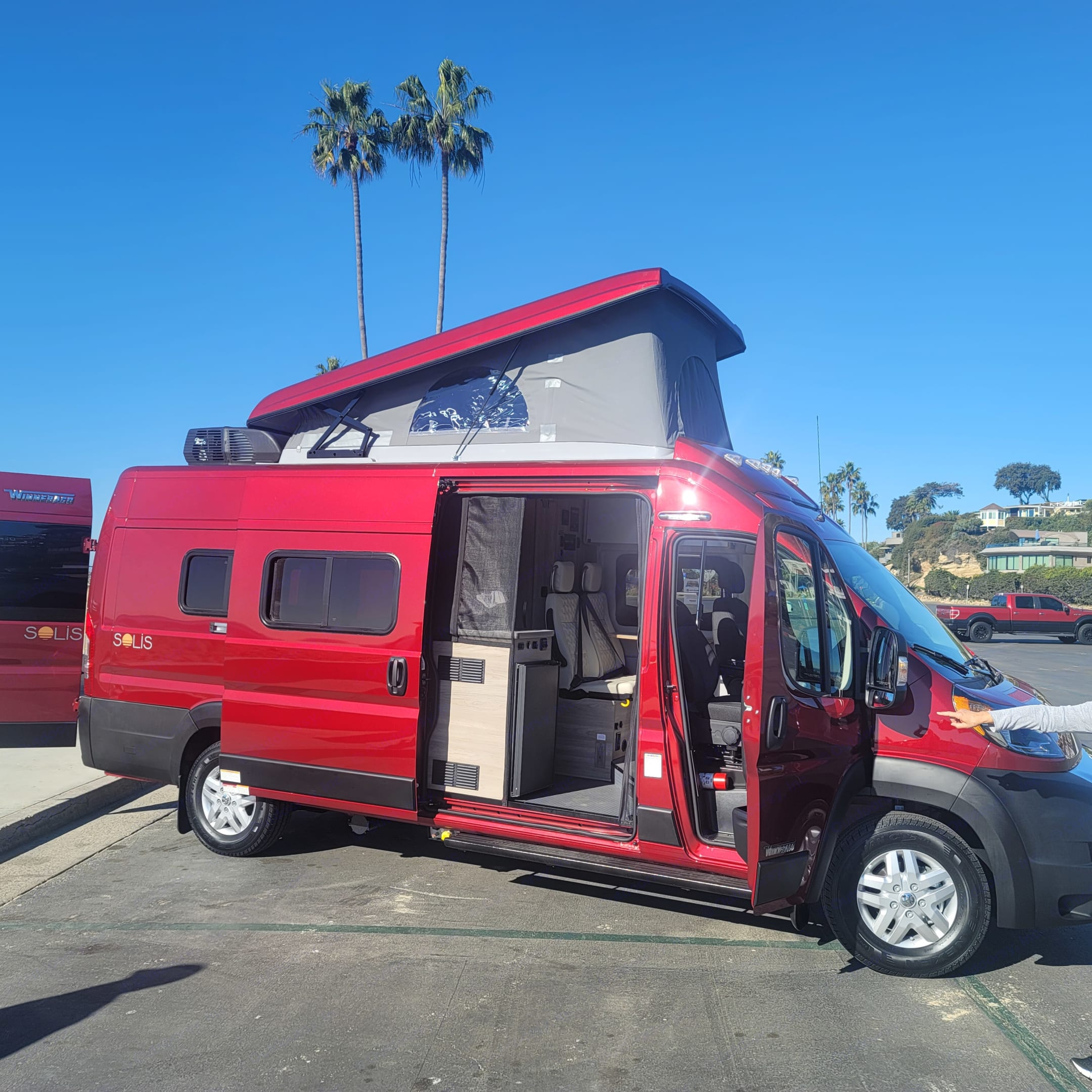 Pop up top provides a full bed with a static window and a full zip-screen window.. Winnebago Solis PX 2021