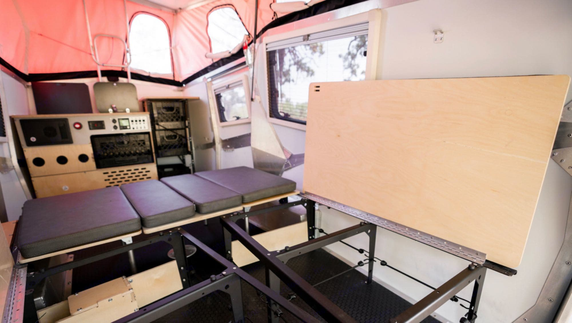interior view from rear hatch when open. there's 25 cubic feet of storage under the bed/seats. TAXA Outdoors Cricket Camper 2021