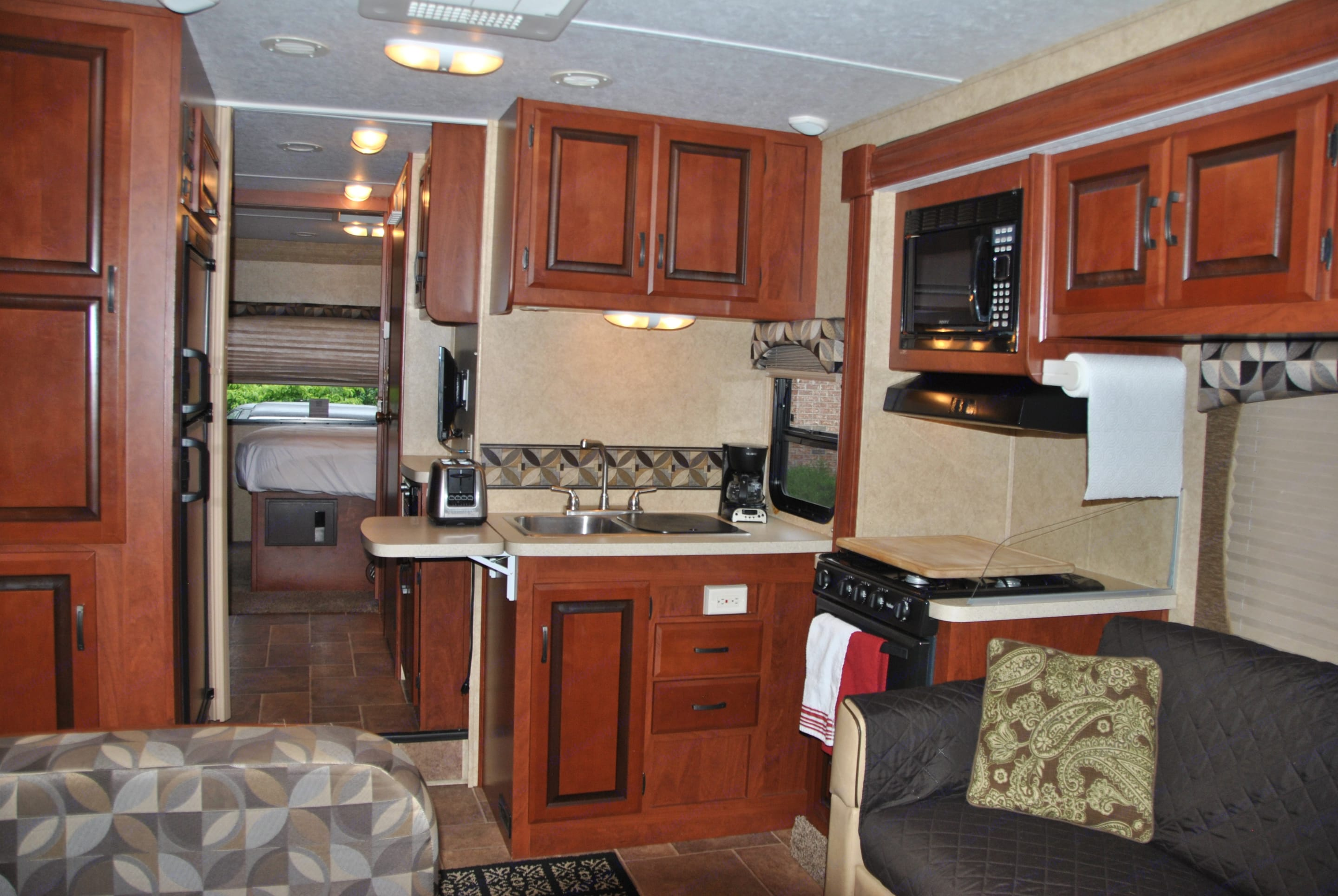 Kitchen is fully equipped with plates, bowls, utensils, pots and pans for your use.. Forest River Sunseeker 2012