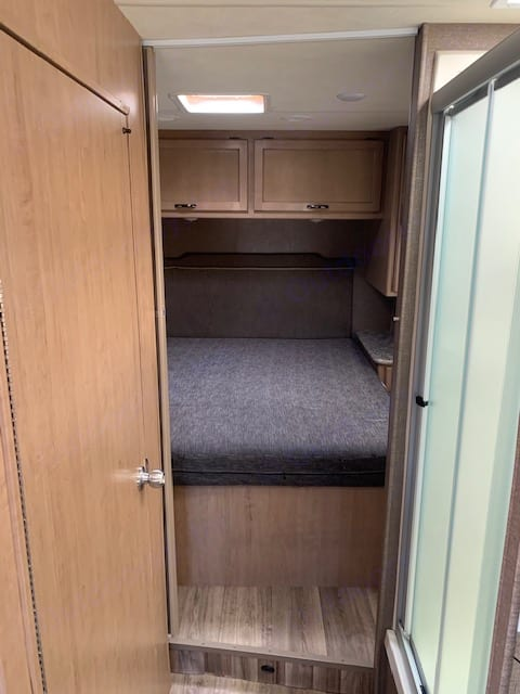 Queen size rear master with extra storage.. Thor Motor Coach Four Winds 28A 2019