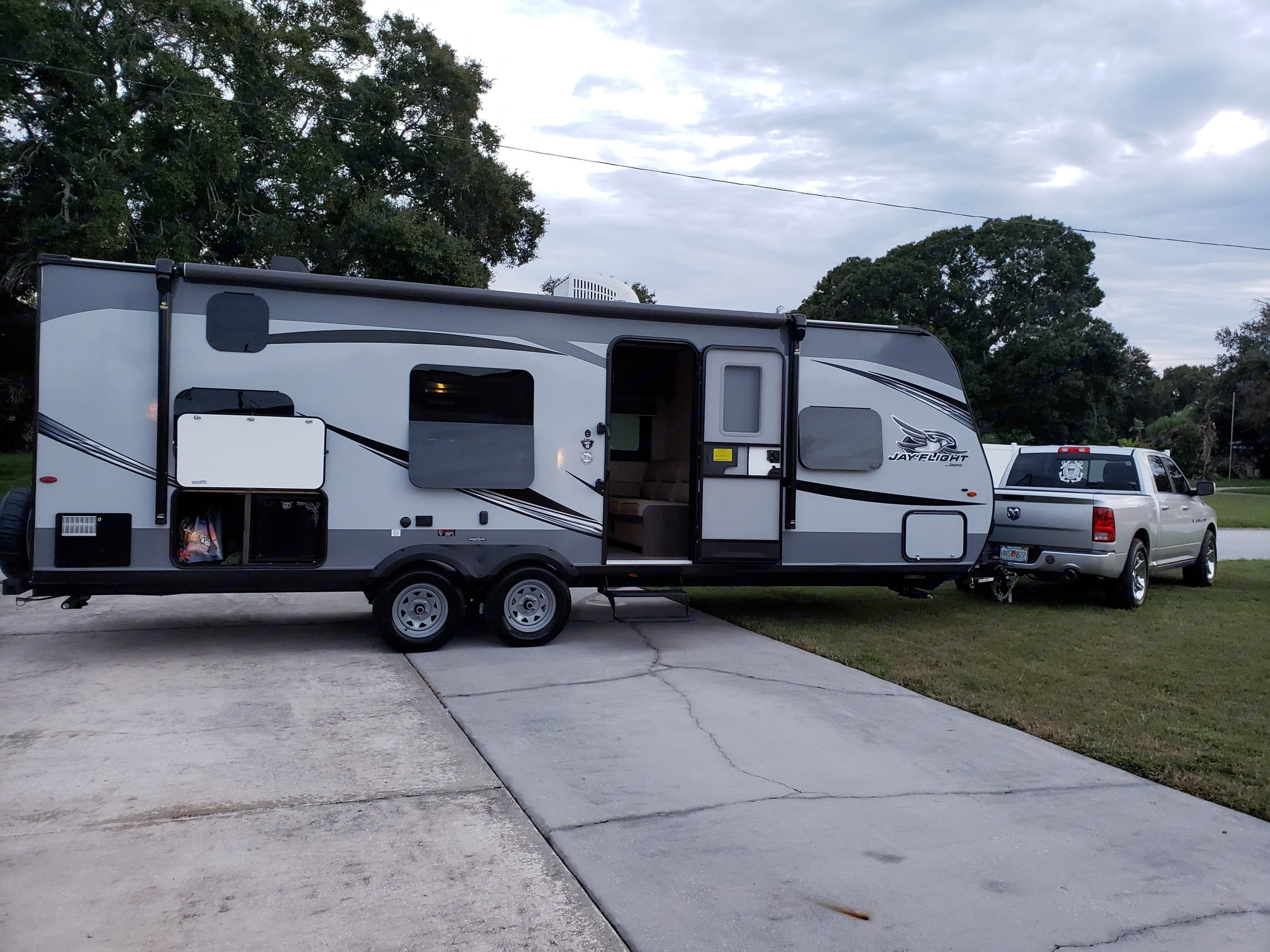 Exterior of camper, showing rear storage with outdoor mini-fridge.  Trailer also includes front storage on both sides.. Jayco Jay Flight 2020