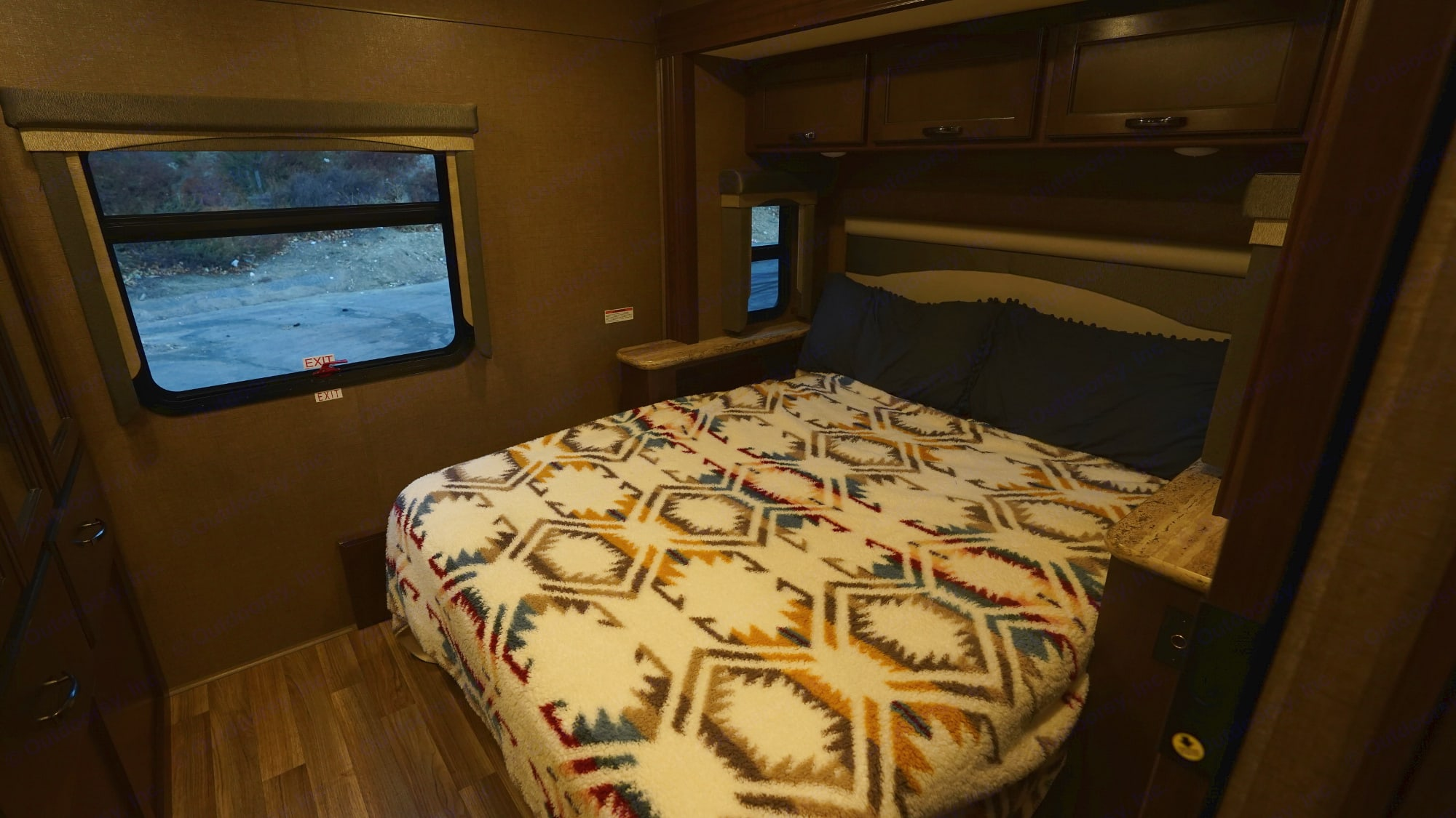 Queen size bed in the bedroom on a slide out to add extra floor space.. Thor Motor Coach A.C.E 2020