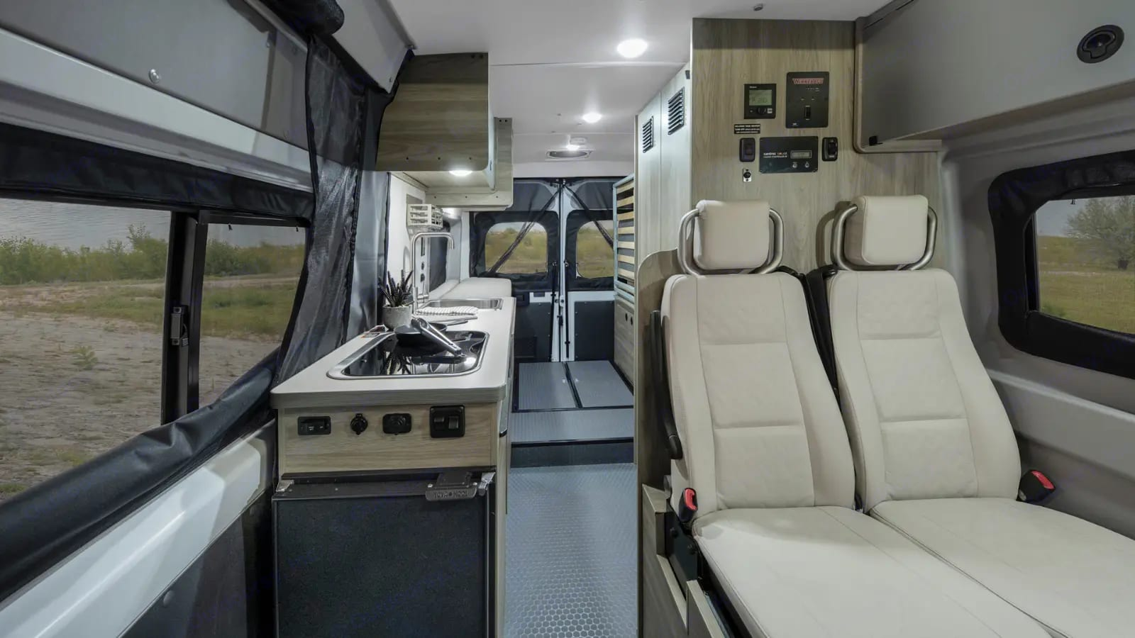 """The Solis layout is both functional and comfortable. The rear bed is """"murphy bed style"""" can be stored up or down.. Winnebago Solis PX 2021"""