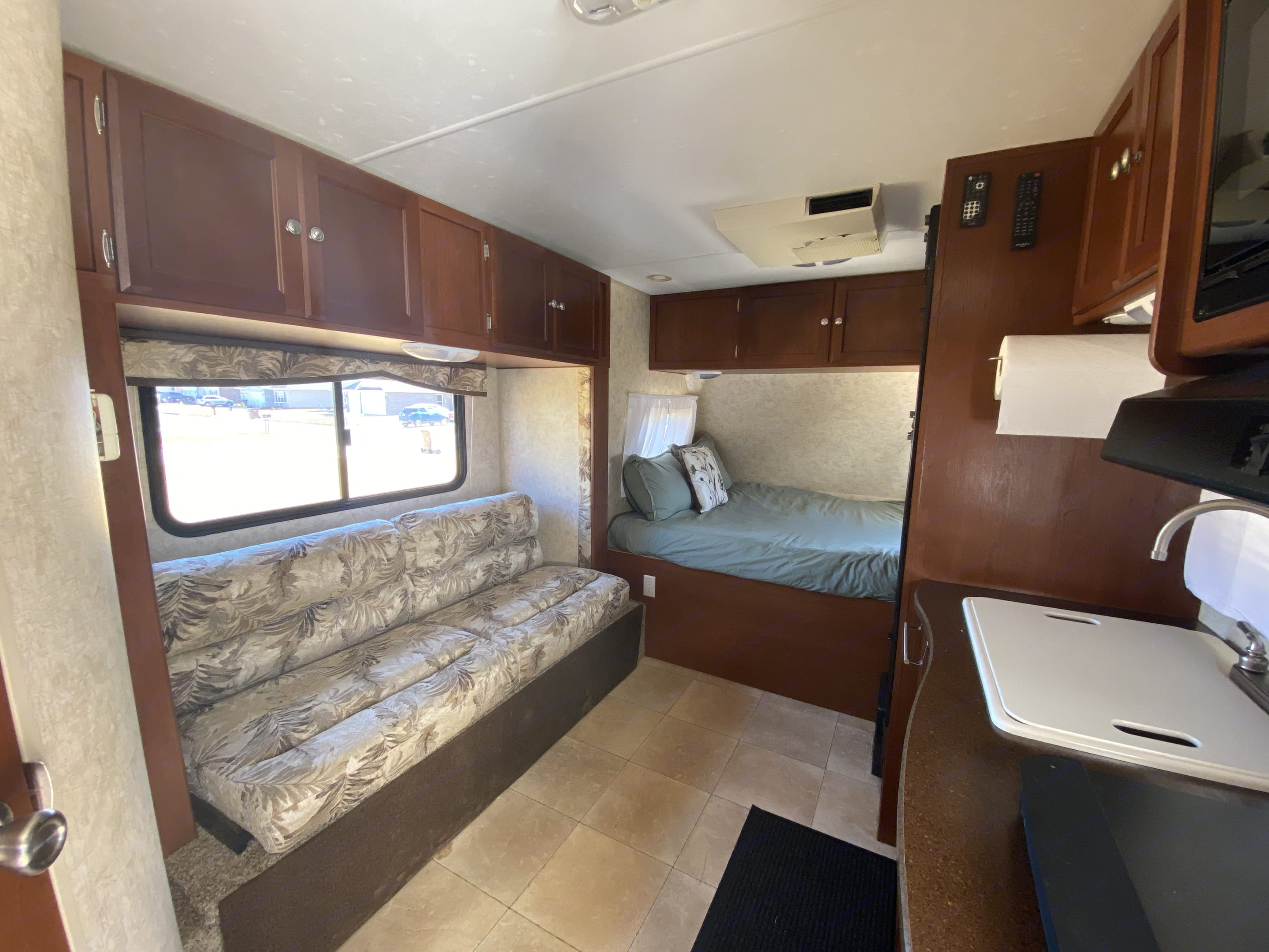 Foldout couch, queen bed up front, kitchen on the right. Dutchmen Kodiak 2011