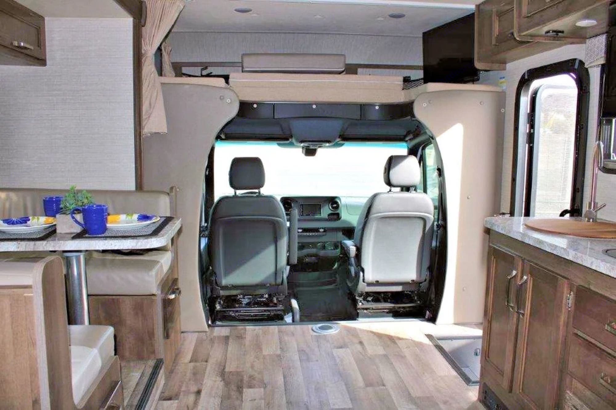Vinyl floors add a homey feel to this rig. Both driver and passenger chairs swivels all the way around.. Jayco Melbourne 2020