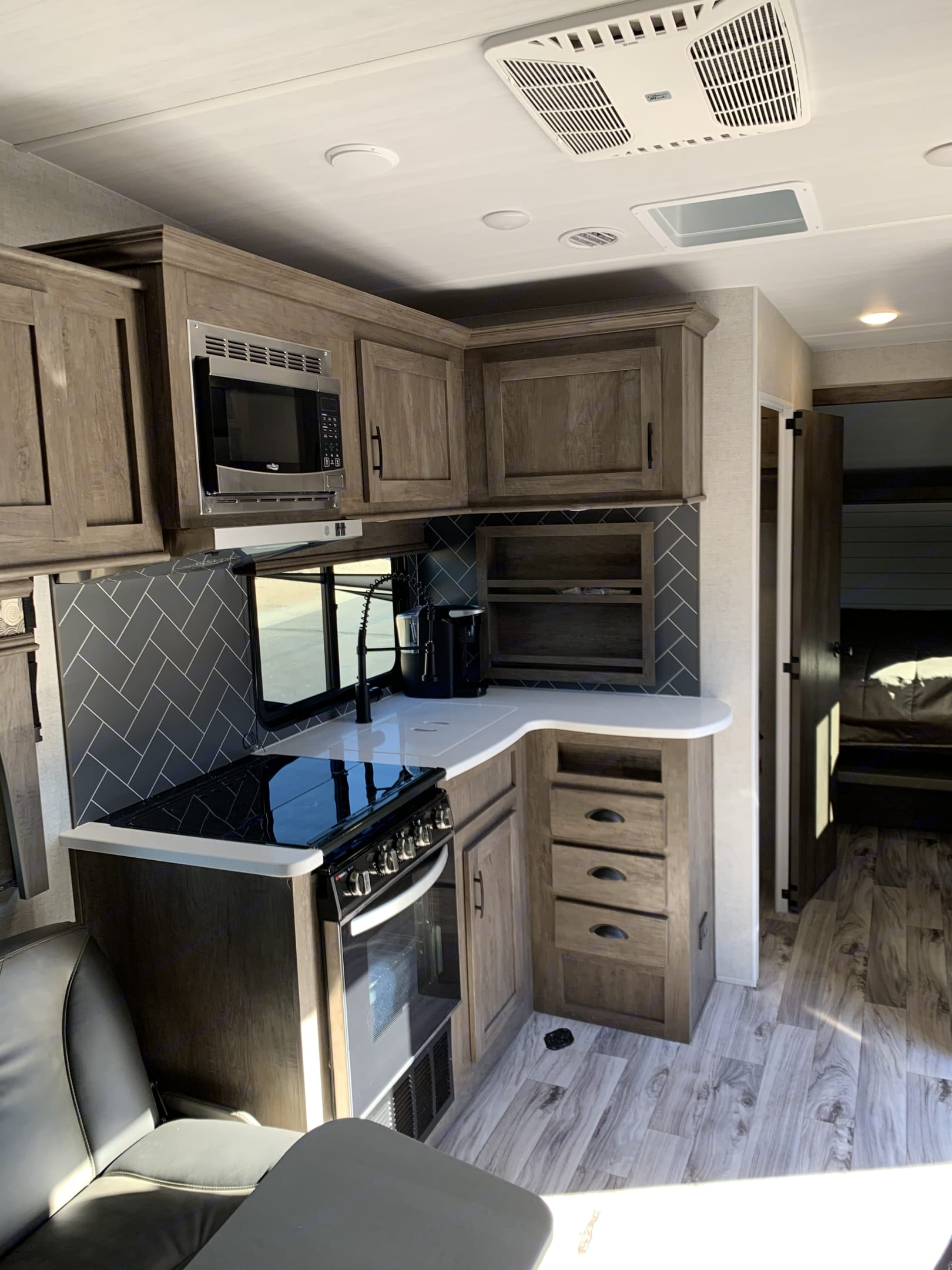 Kitchen with full amenities.. Forest River Sandstorm 2021