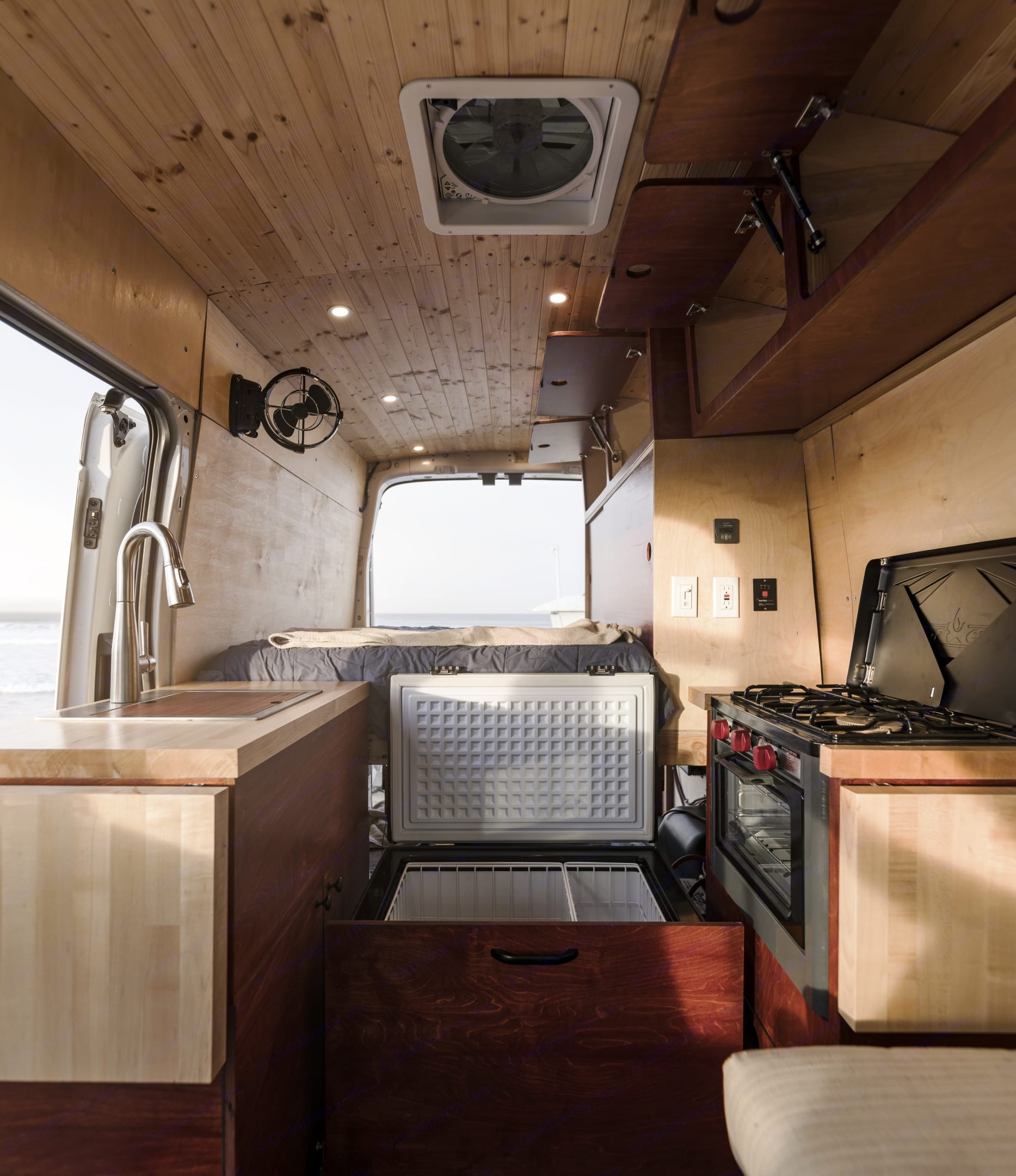 Prepare meals like Gordon Ramsey! Ample space in the kitchen and best part is you can stand up while cooking/walking. We are 6'2 and fit perfectly!. Ford Transit 2019