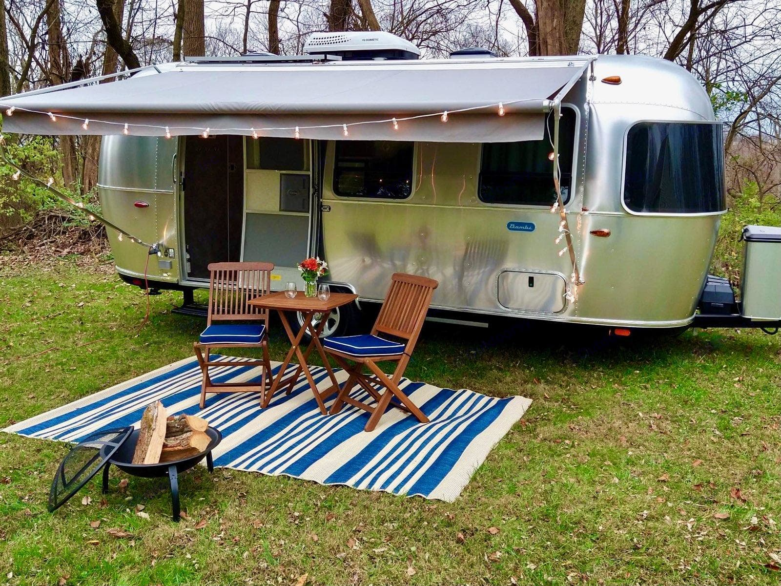Beautiful exterior setup (table, chairs, carpet, portable fire pit are available as Add Ons). Airstream Other 2021