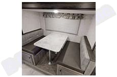 Dinette, also converts into bed for additional sleeping. Coachmen Apex Nano 194 BHS 2021