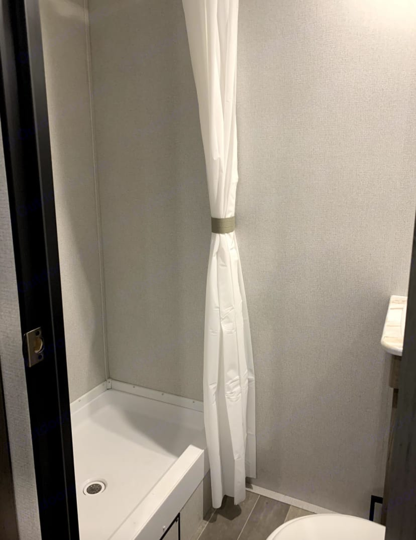 Upgraded shower head for better pressure in shower. . Keystone Hideout 2020