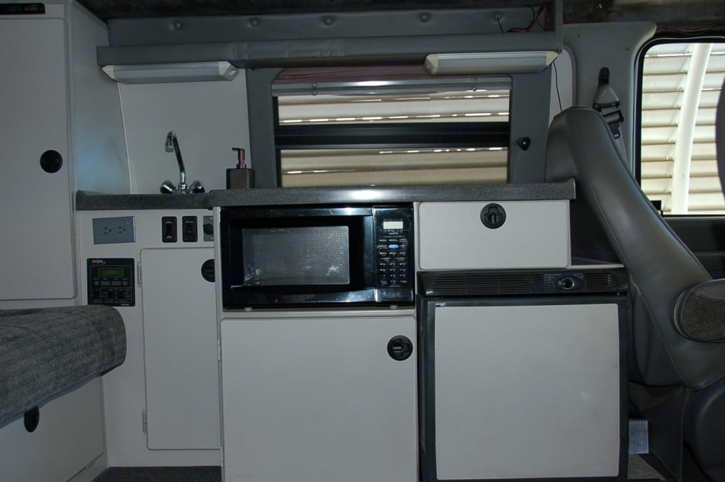 Sink, microwave, refrigerator. Sportsmobile E350 2003