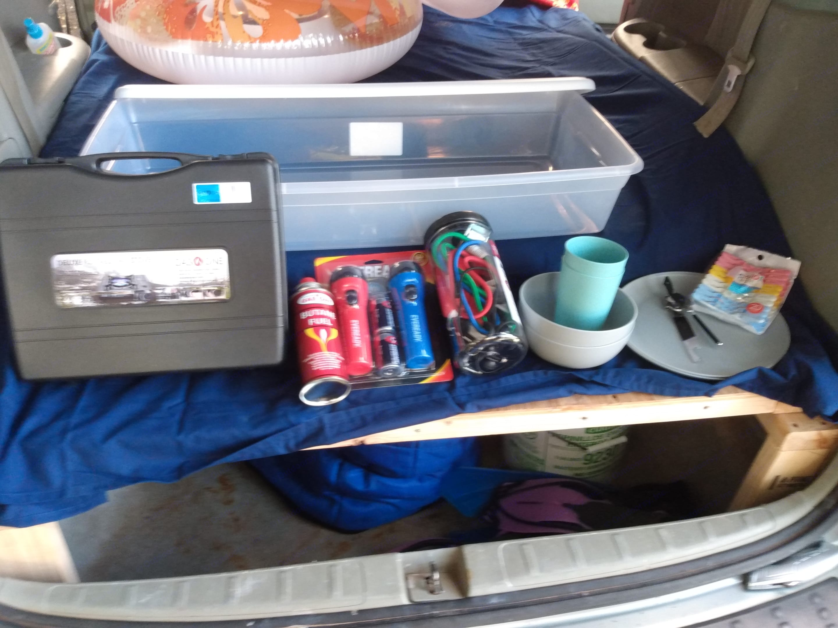 Flat storage box under the bed platform includes new propane burner, mess kit and miscellaneous items. Honda Odyssey 2005