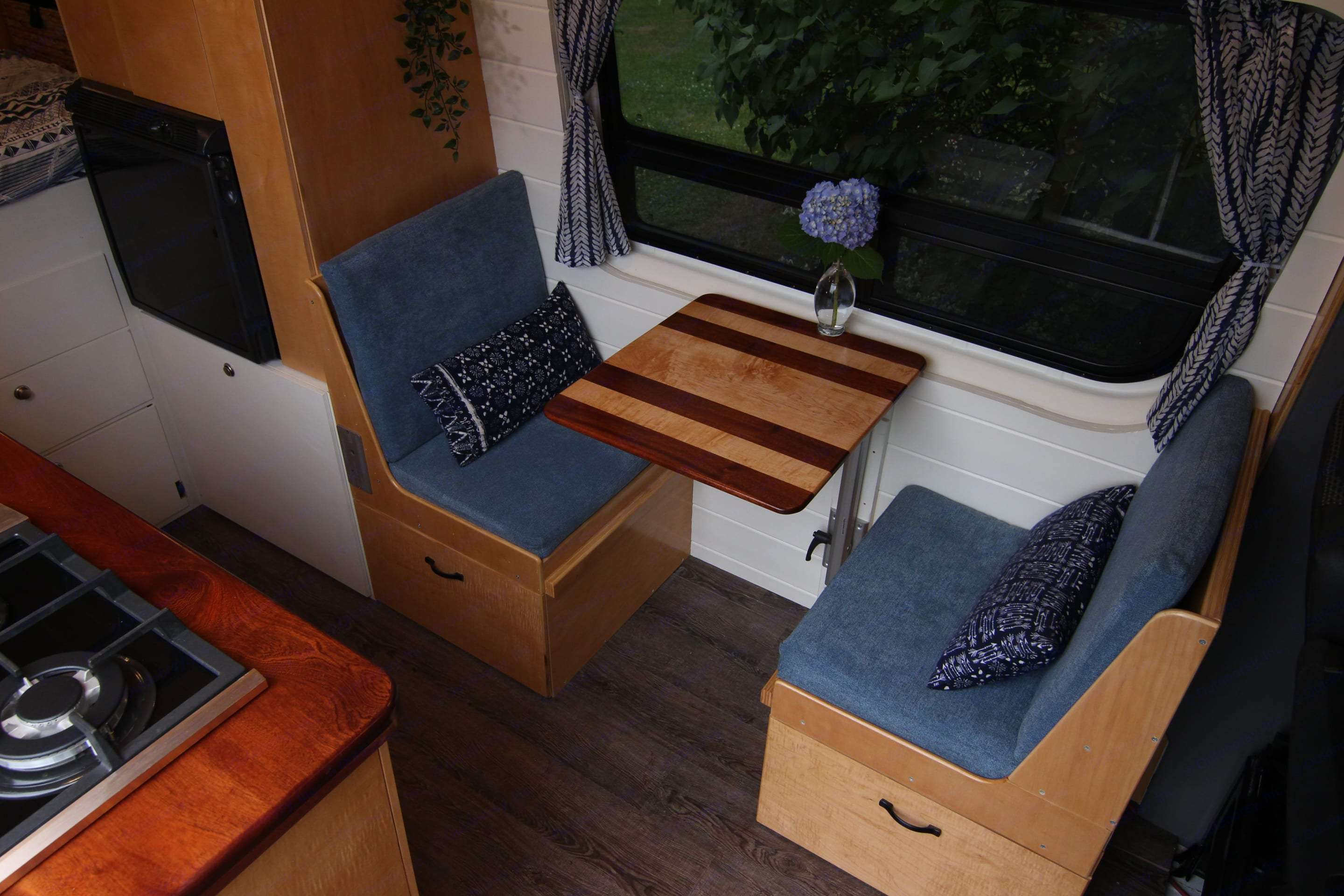 Comfortable dinette with articulating table and large storage drawers below.. Mercedes-Benz Sprinter 2012