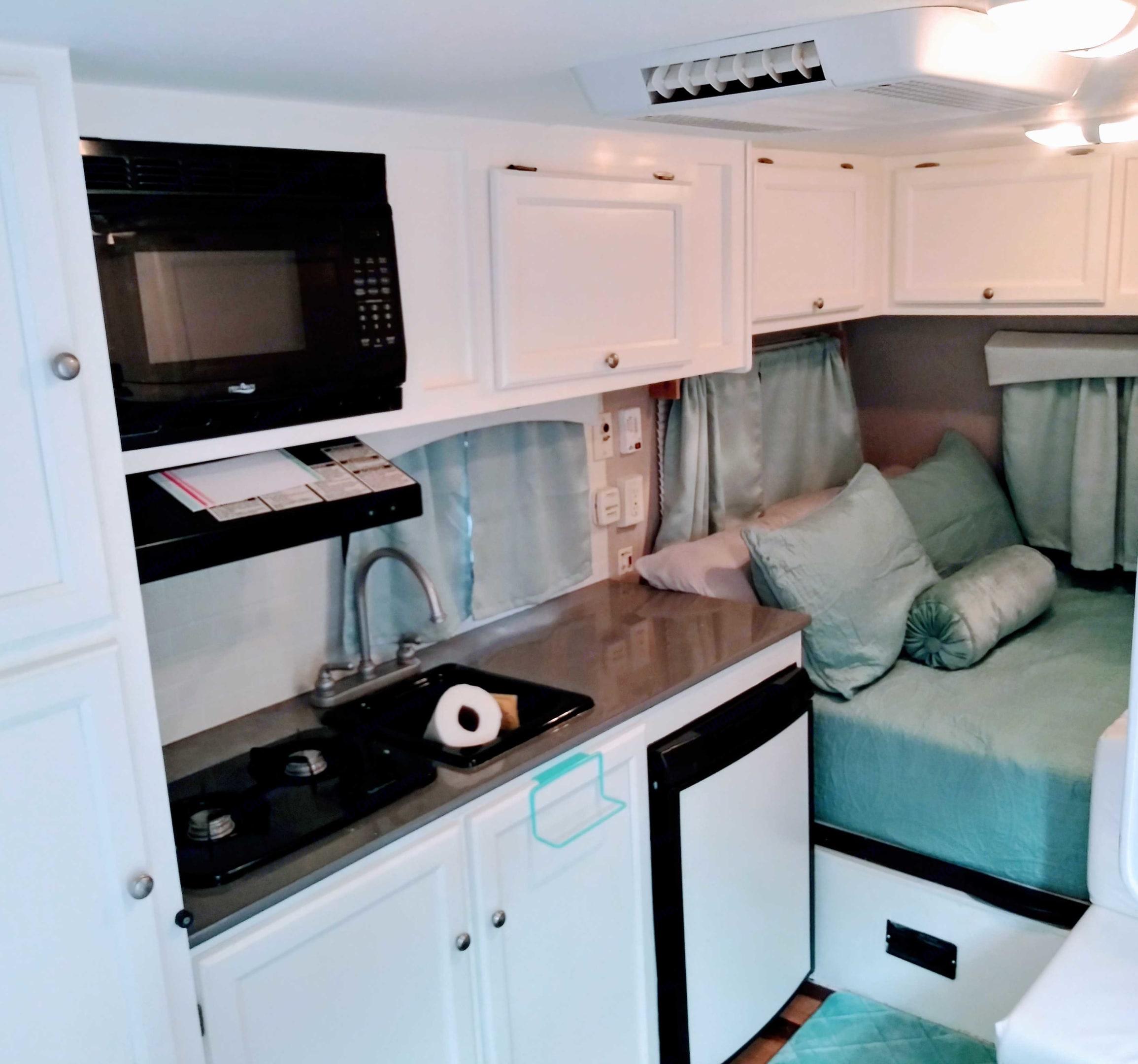 Kitchen area.  2 burner stove, Refridgerator/Freezer, Microwave.. Coachmen Clipper 2013