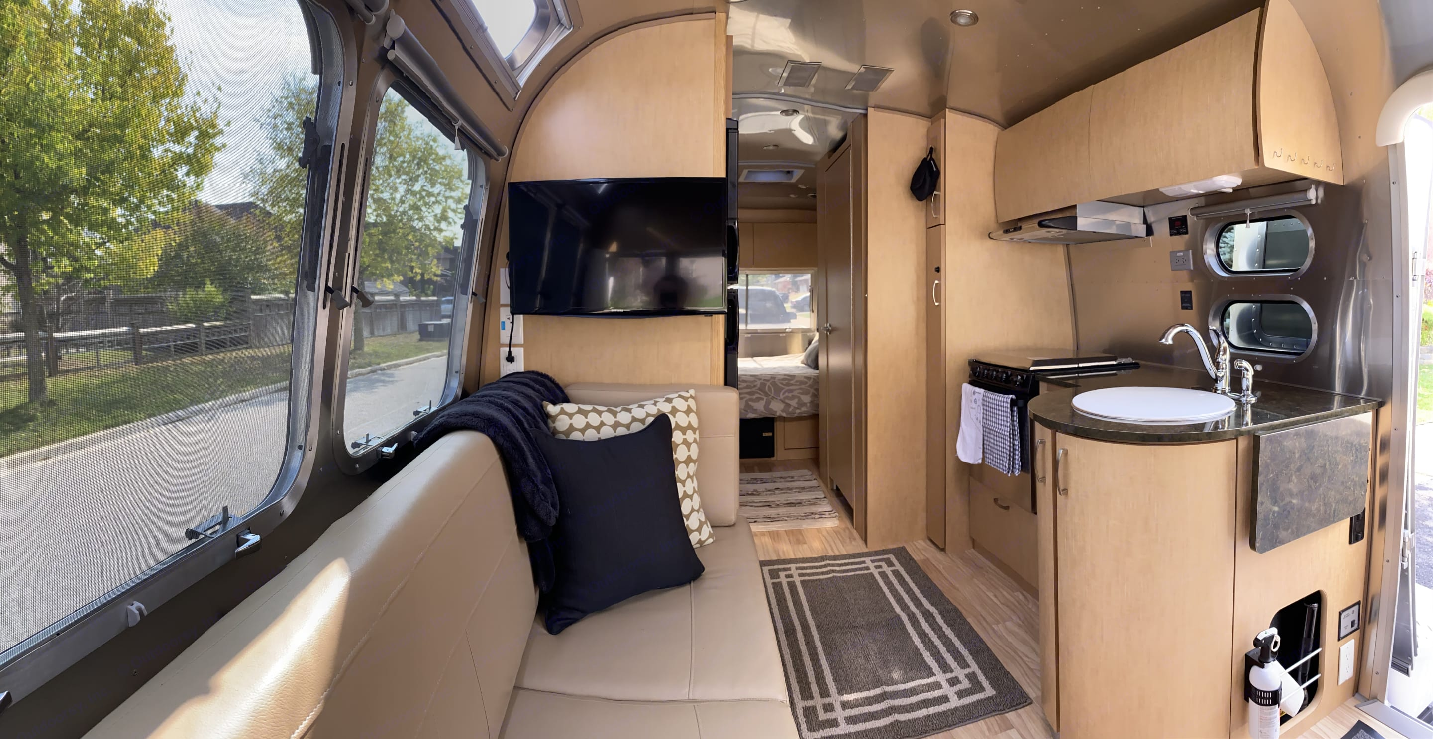 A bright, functional and spacious kitchen with TV in living area.. Airstream Flying Cloud 2016