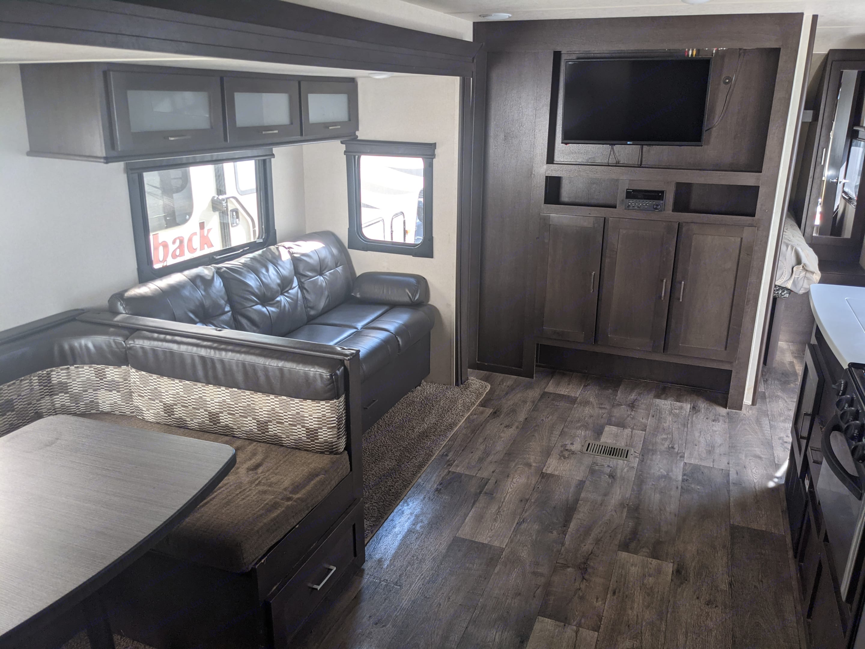 Sofa and dinette convert to beds. Forest River Wildwood 2018