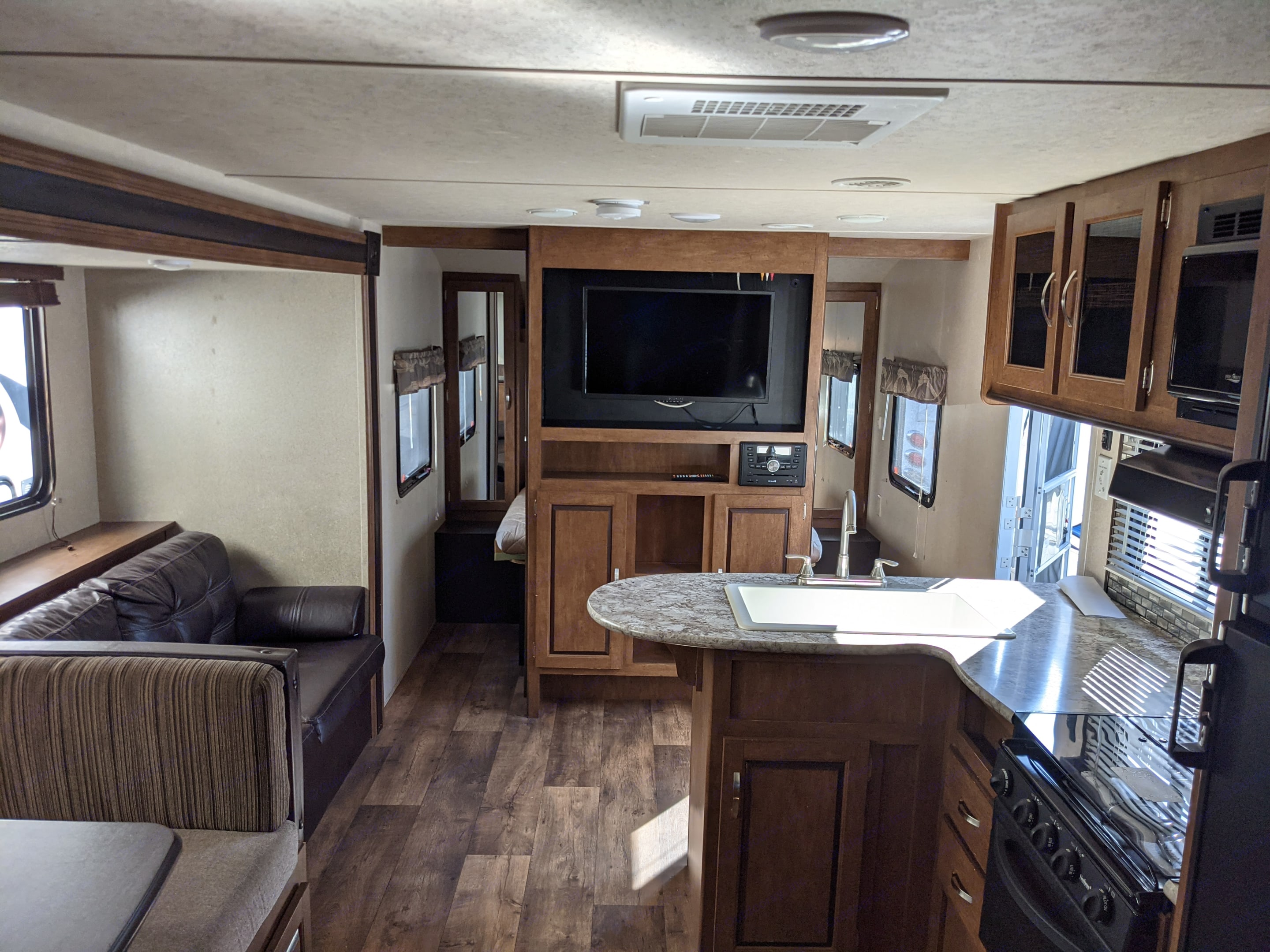 Sofa and dinette convert to beds. Forest River Wildwood 2017