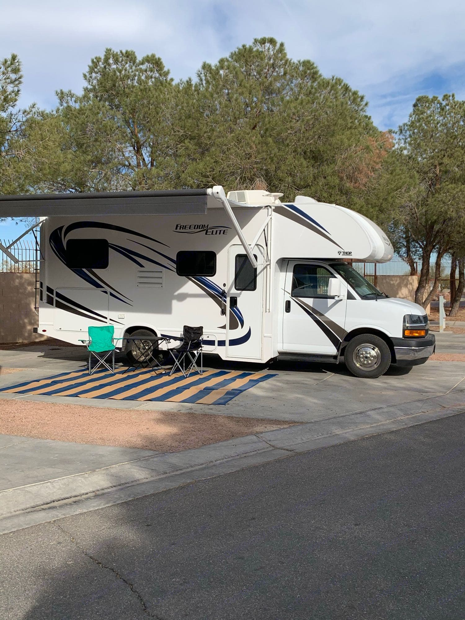 Electrical awning with LED lights. Two camping chairs, table and outdoor rug, included with your rental. . Thor Motor Coach Freedom Elite 2019