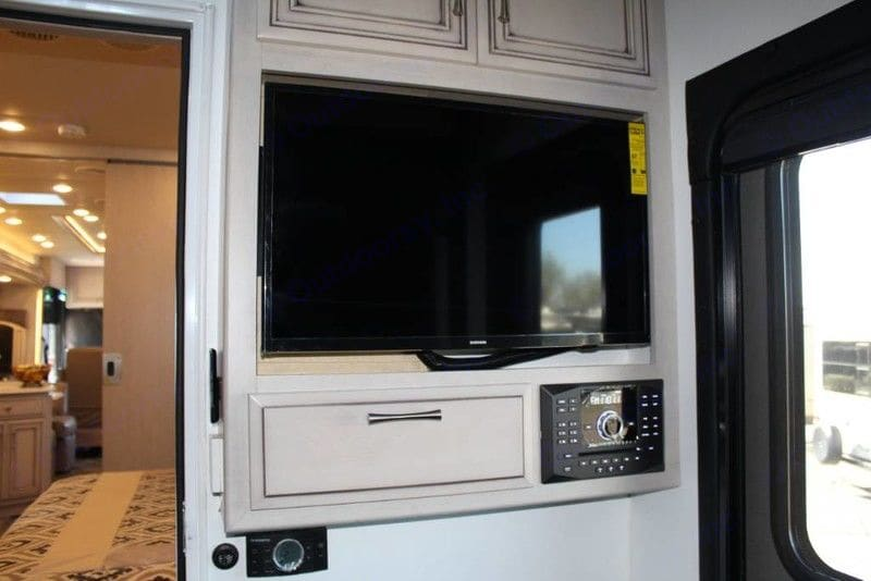 TV and stereo in back bedroom area of Toy Hauler. Newmar Canyon Star 2020