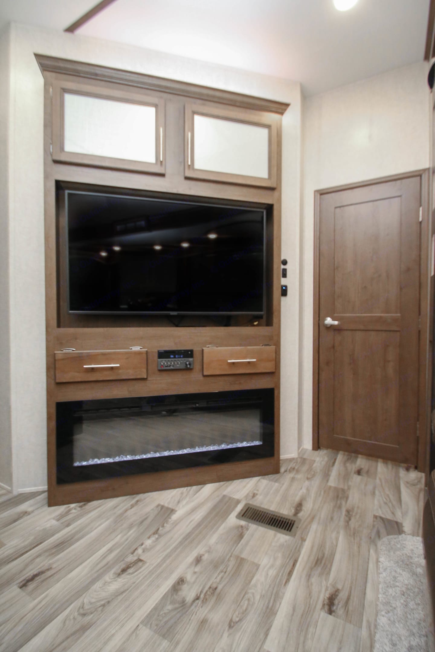 Enjoy a flat screen TV and fireplace while relaxing at night. . Keystone Cougar 2020