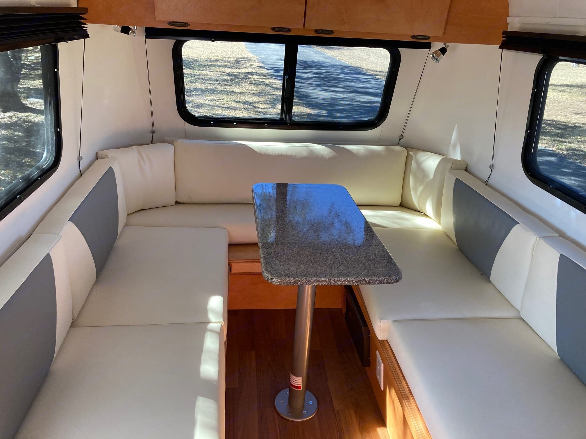 Extra storage under the benches and electric plugs at your feet. Windows open and close. . Meerkat Mini trailer 2020