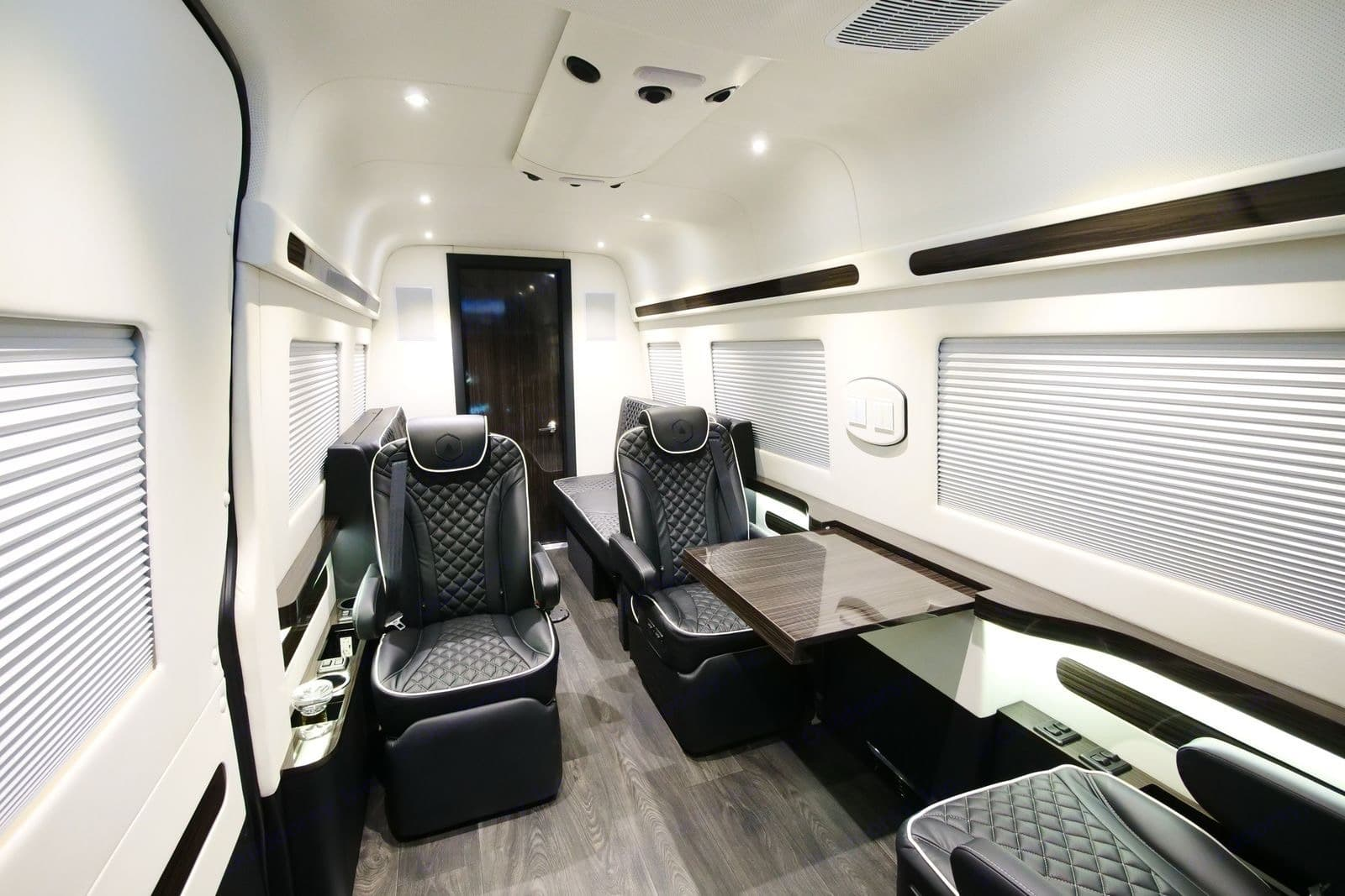 The executive suite gives you focus time.. Mercedes-Benz Custom Coach 2018