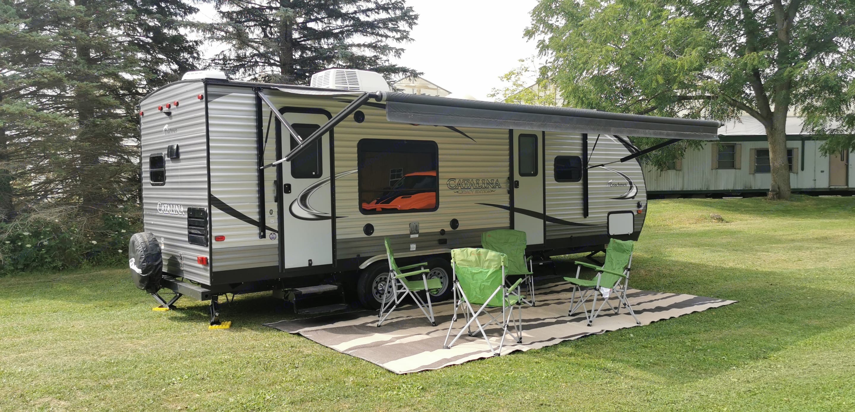 Large awning to cover seating area with 4 included lawn chairs and ground cover.. Coachmen Catalina 2016