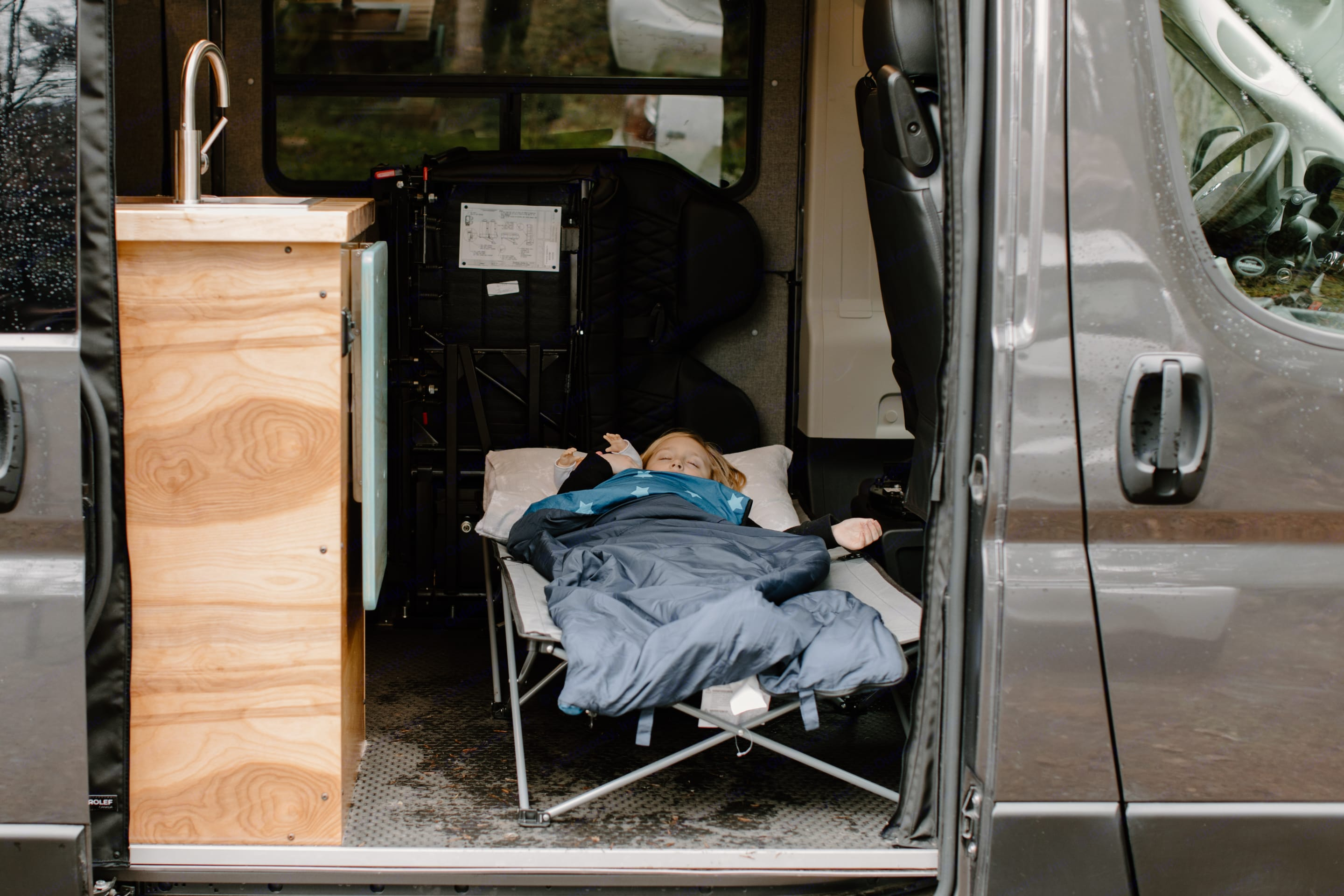 Fold the passenger chairs and there's room for an additional sleeping cot.. Dodge Promaster 2020