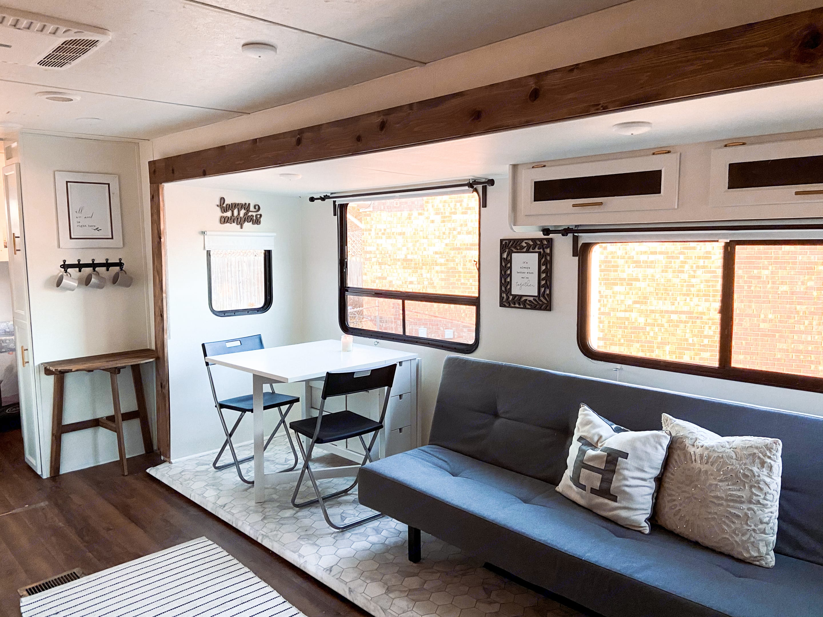 Living area with extendable dining table and futon/couch.. Coachmen Catalina 2017