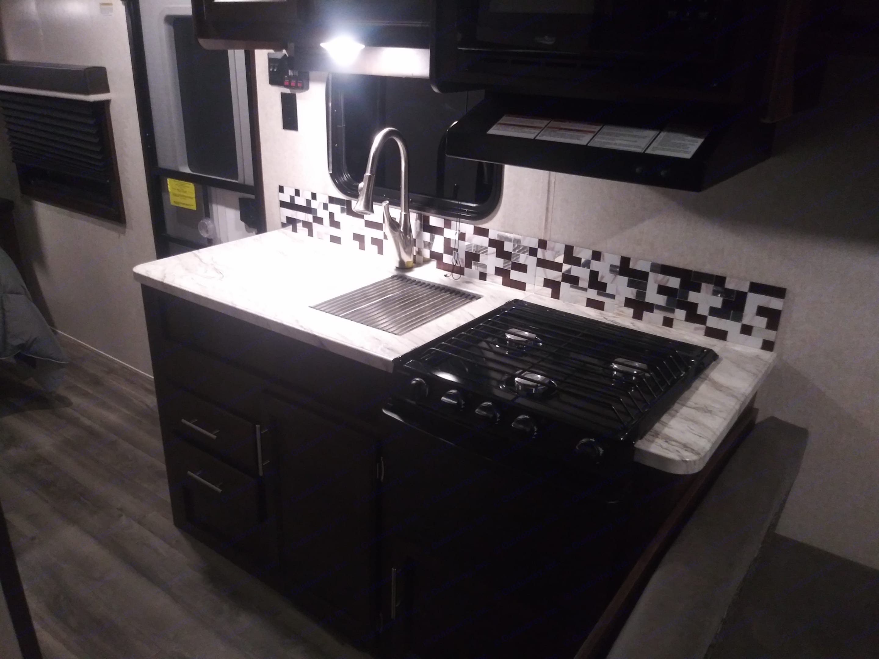 Full kitchen with mircowave and a propane oven.  Electric or propane powered refrigerator/freezer.  Basic utensils and dishes included . Jayco Jay Flight 2019
