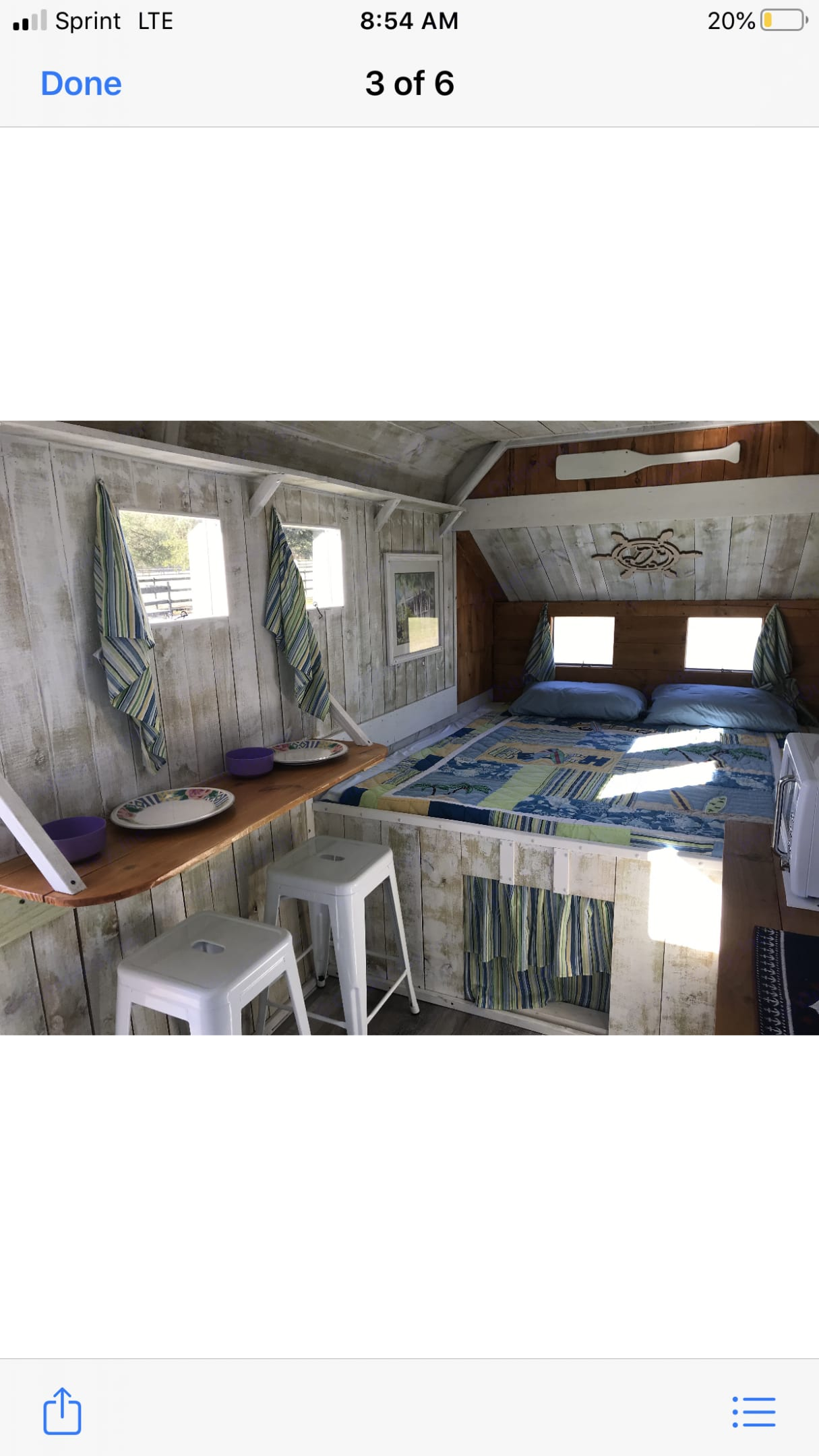 Across from the kitchen, you see the dinning. The curtain on the bottom is storage. . Hoosier Horse Trailers Custom 2021