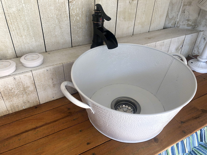 It IS a bucket. It's also a nifty working sink. . Hoosier Horse Trailers Custom 2021