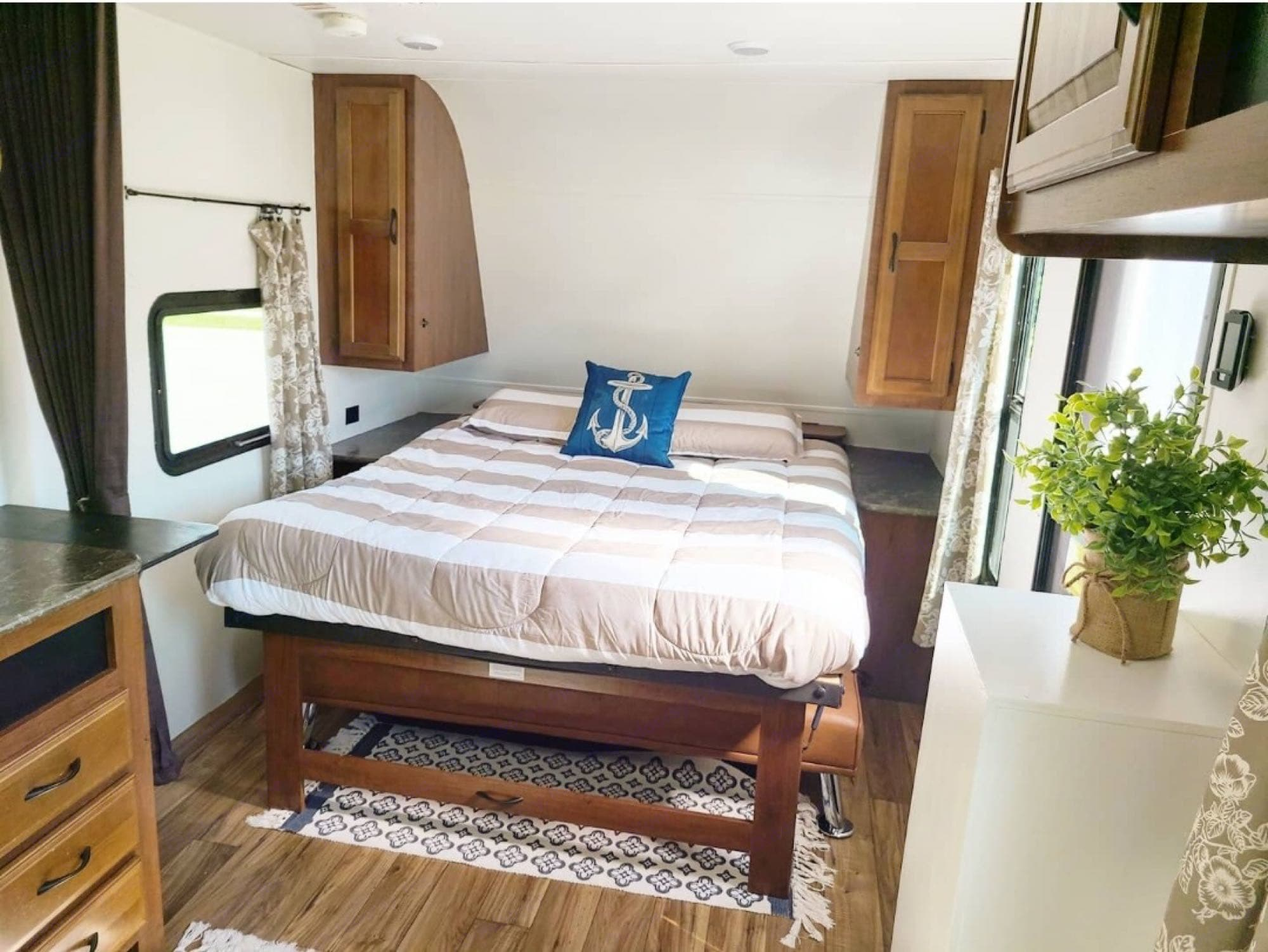 Queen size Murphy bed with wardrobes and charging stations in each side. Jayco Jay Flight 2016