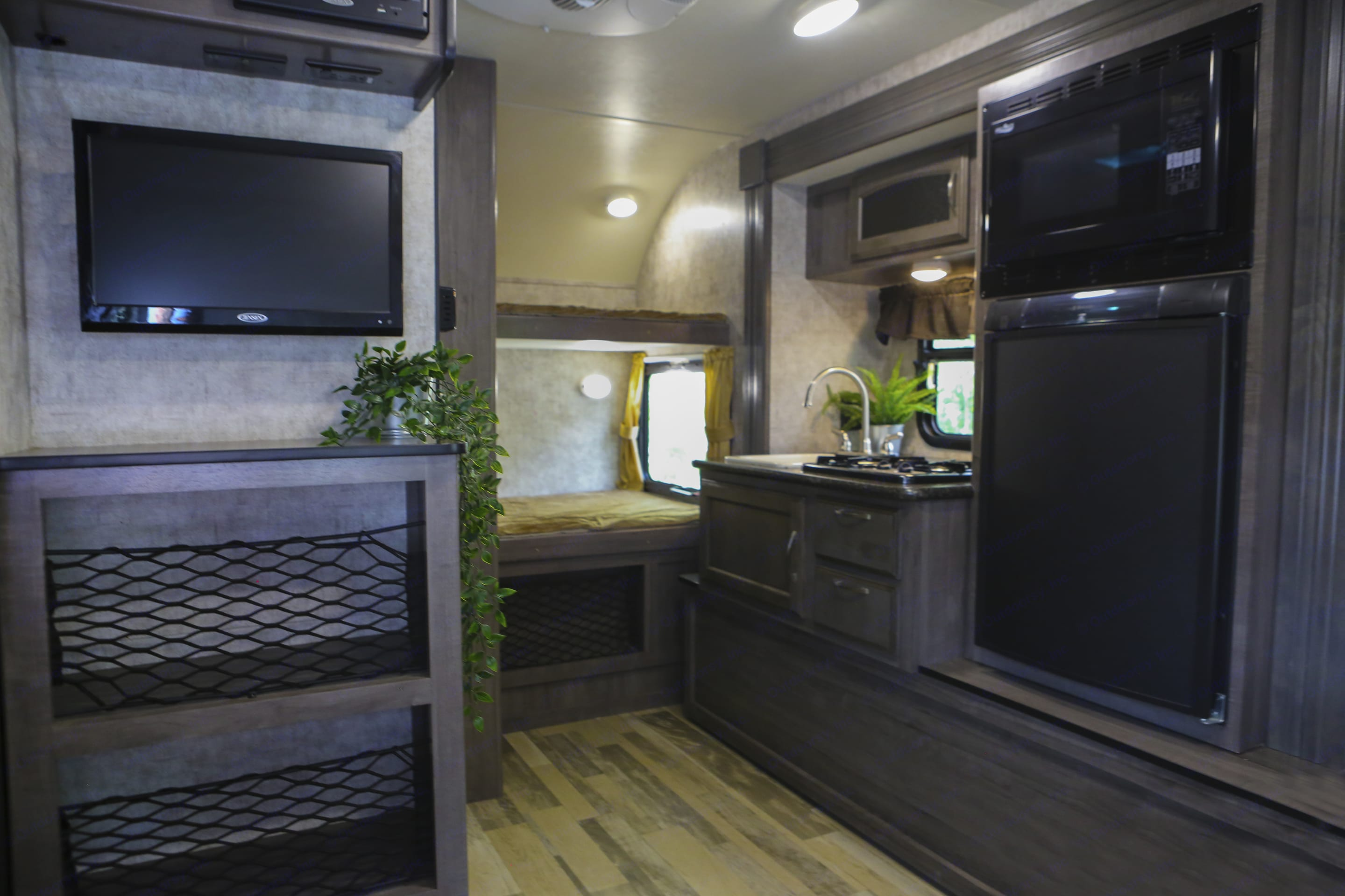 The refrigerator can run off 30 amp shore power or propane when no hooks ups are available. The heater also runs off propane gas.  . Winnebago Winnie Drop 2017